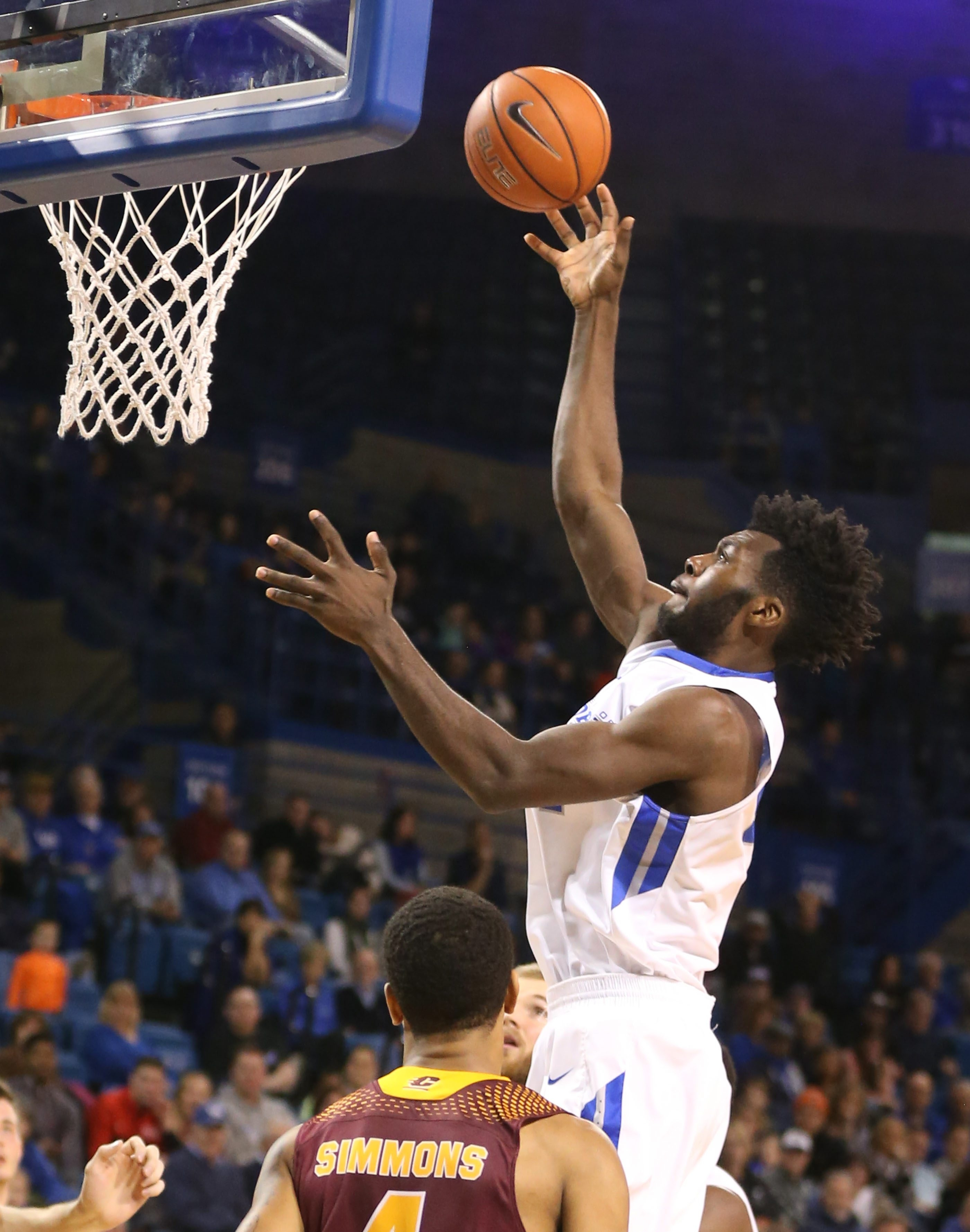 """At 6-foot-10, UB center Ikenna Smart has adapted quickly to the game and sees his role as """"playing hard every game, trying to get all the rebounds, stopping drives to the basket."""""""
