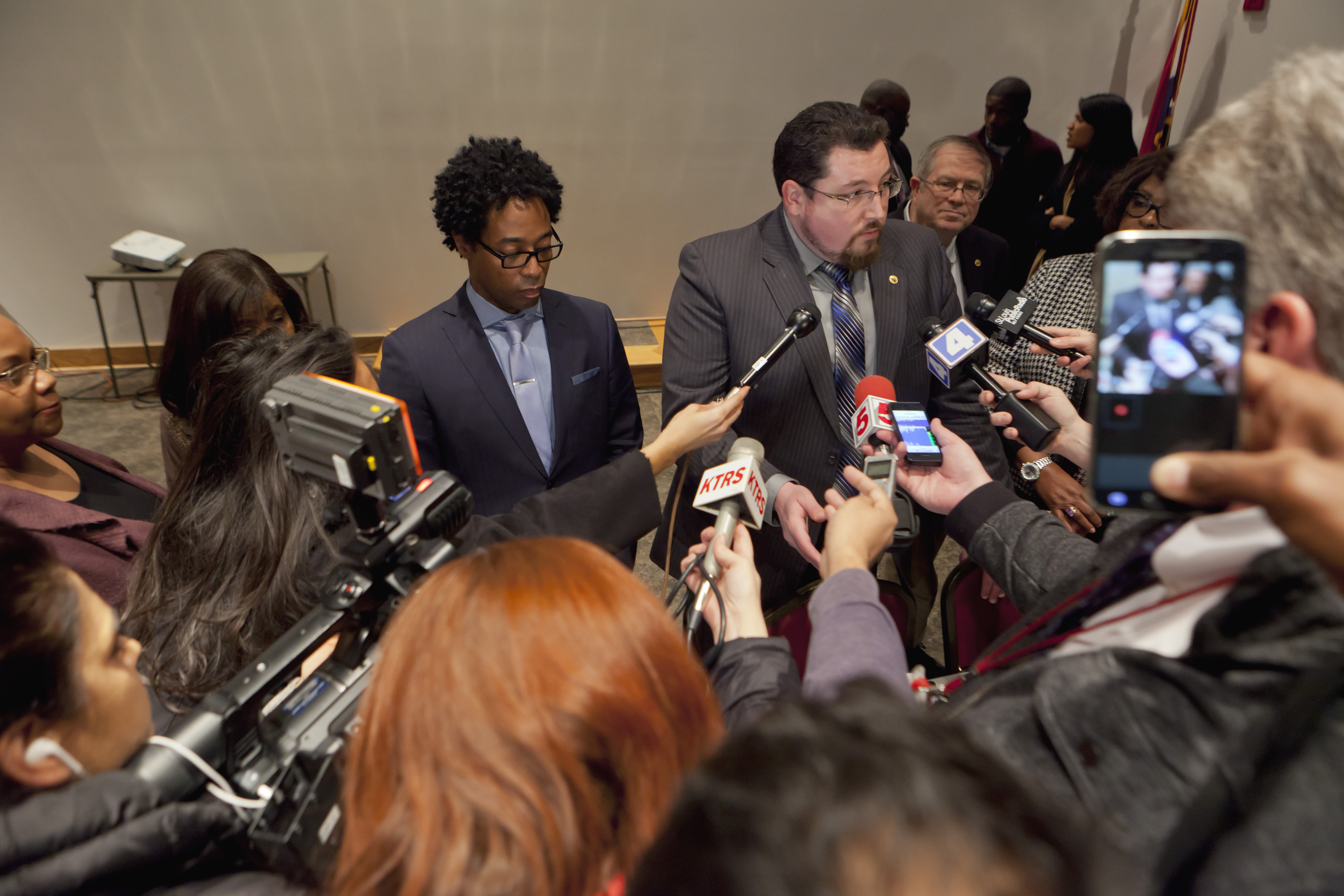 Ferguson Mayor James Knowles and Wesley Bell, left, a city councillor, talk about why the city backed out of a deal to reform its police department. (New York Times)