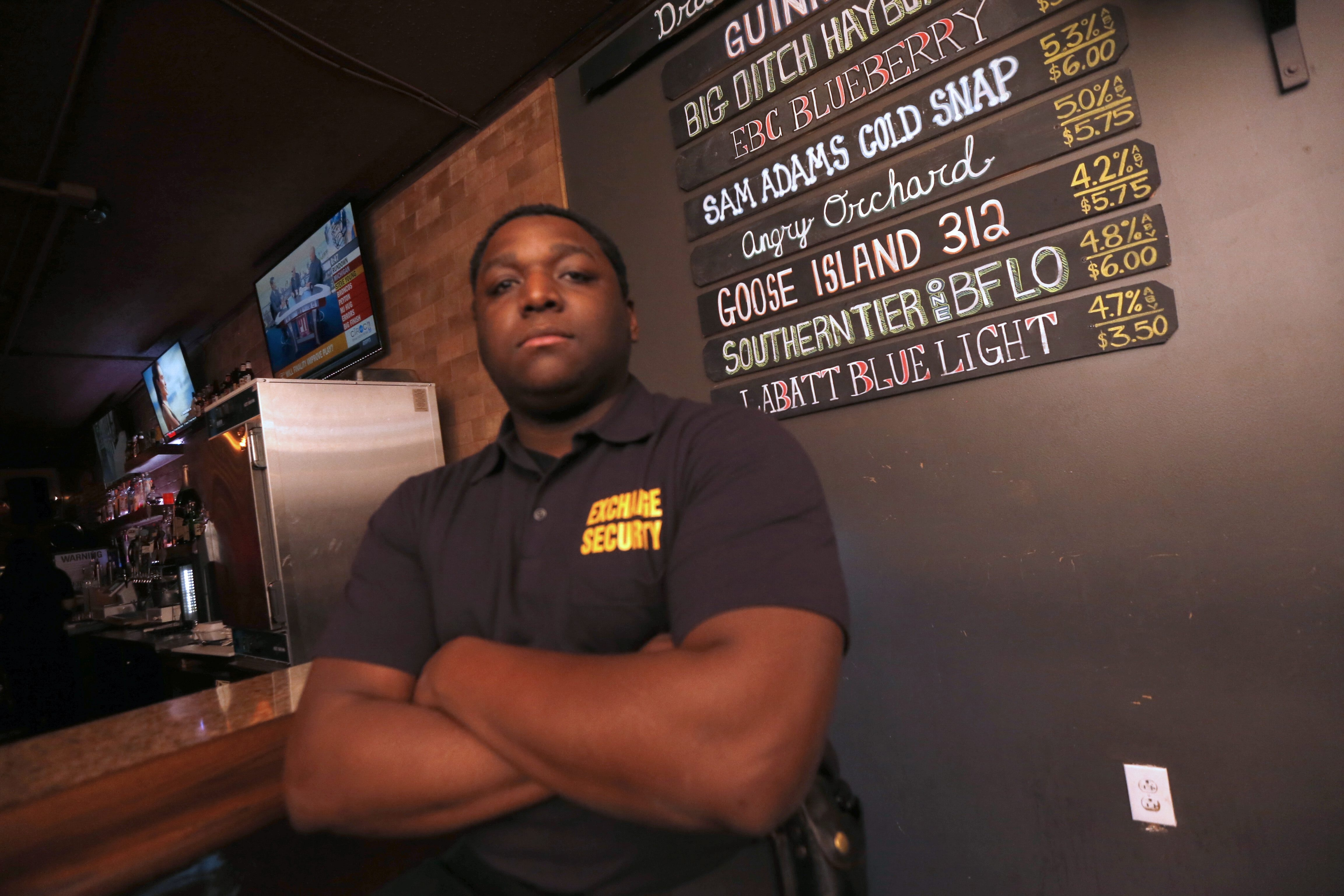 """Paul """"PJ"""" Colvin Jr. works at a construction job during the day and as a bar bouncer at night. He says that ultimately he wants to work as a New York state trooper, just like his father."""
