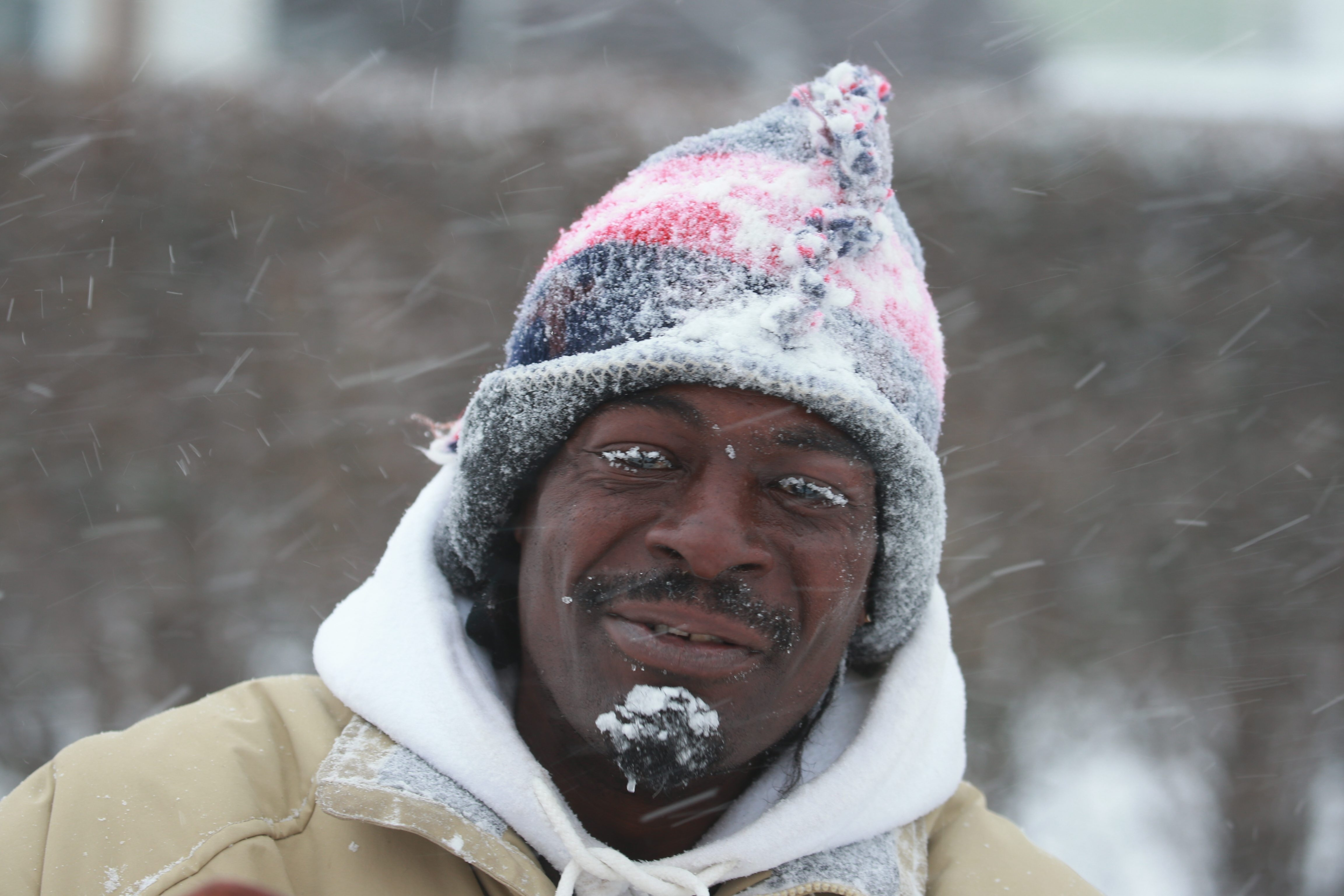 Bryan Allen is snow-covered on his way home off Walden Avenue on Friday, Feb. 12, 2016. (John Hickey/Buffalo News)