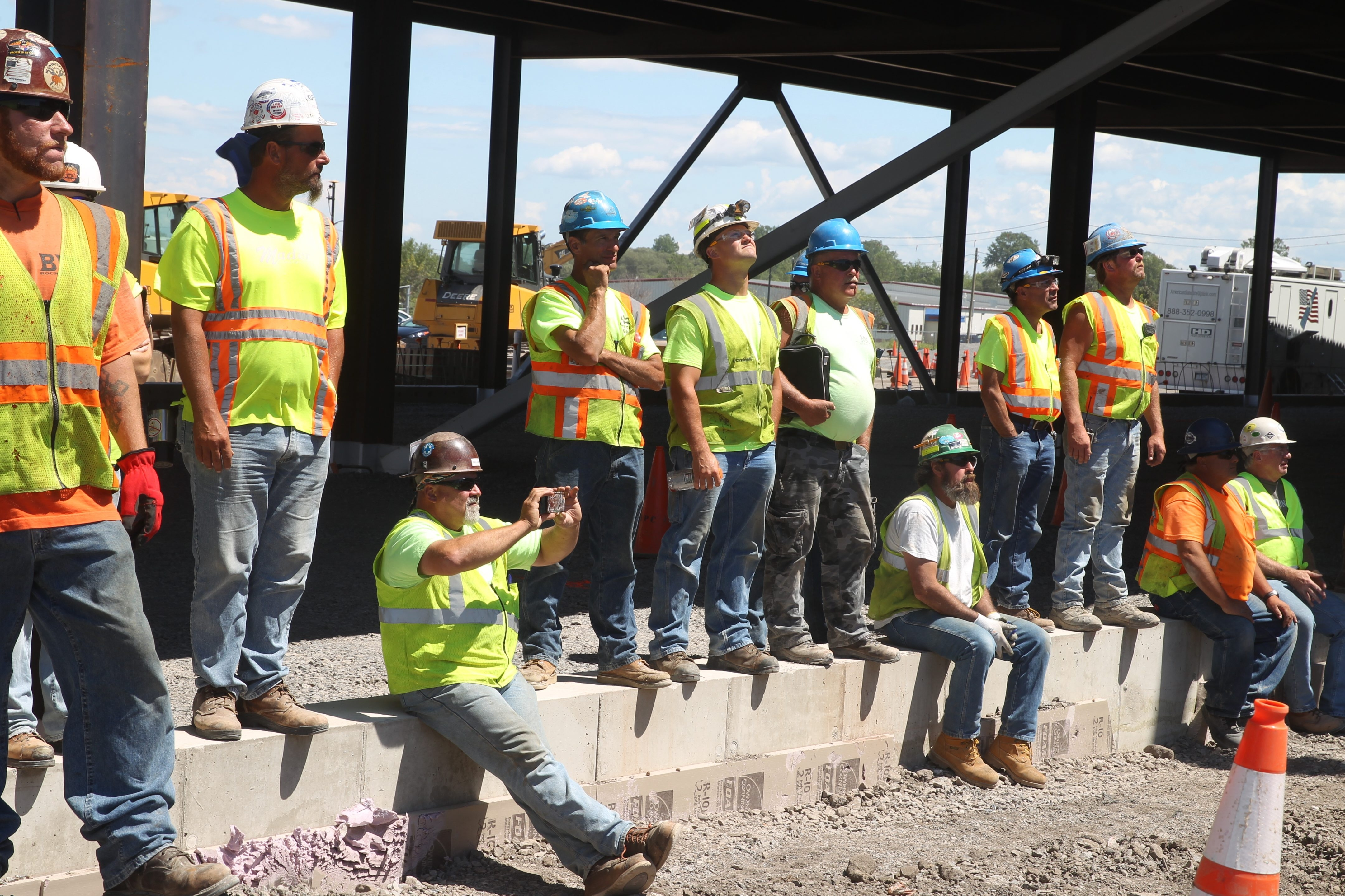 Workers watch in August as a beam is lifted during the topping-off ceremony for SolarCity's massive facility in Buffalo.