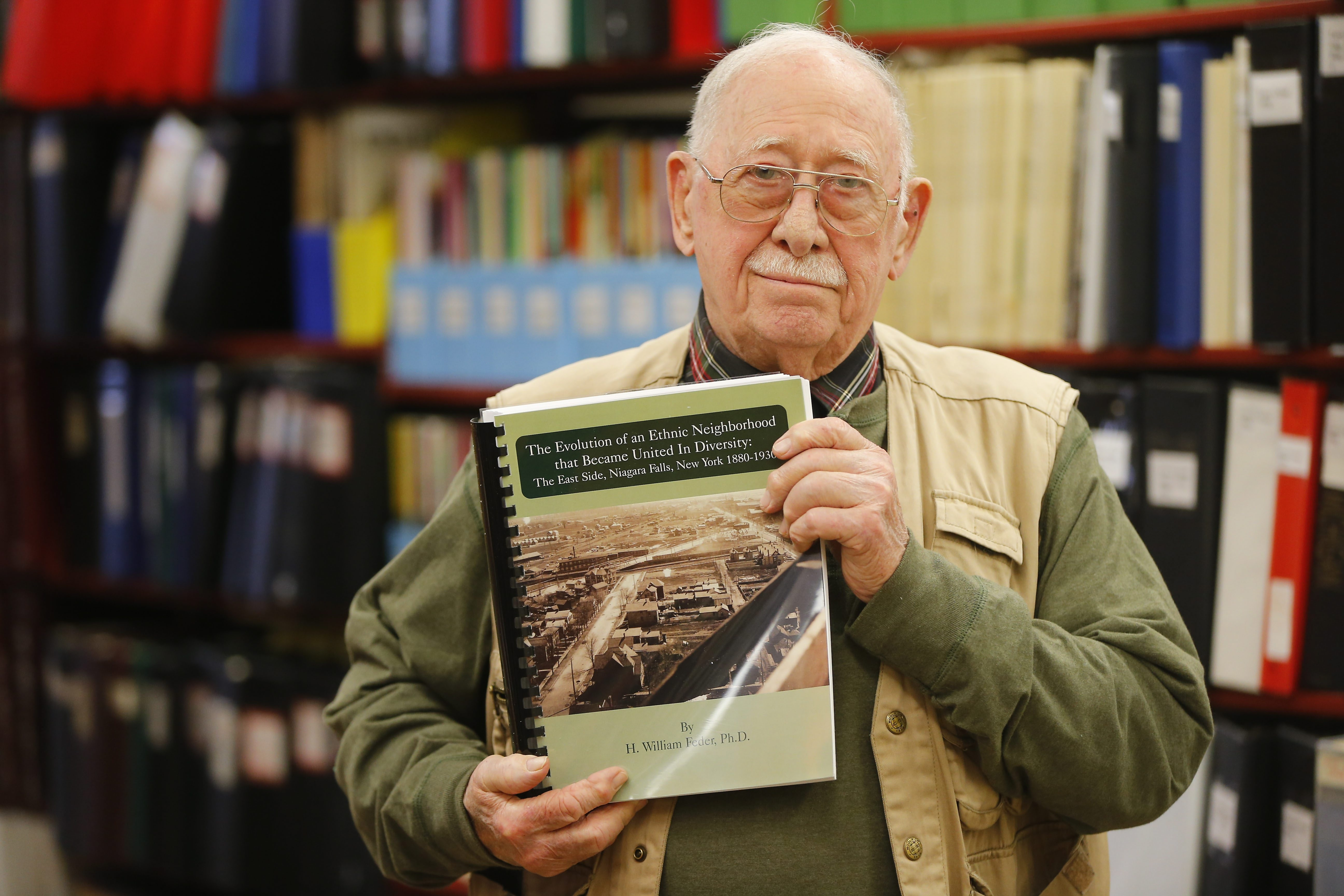 H. William Feder, former historian for Niagara County, holds his book at the Niagara Falls Library.