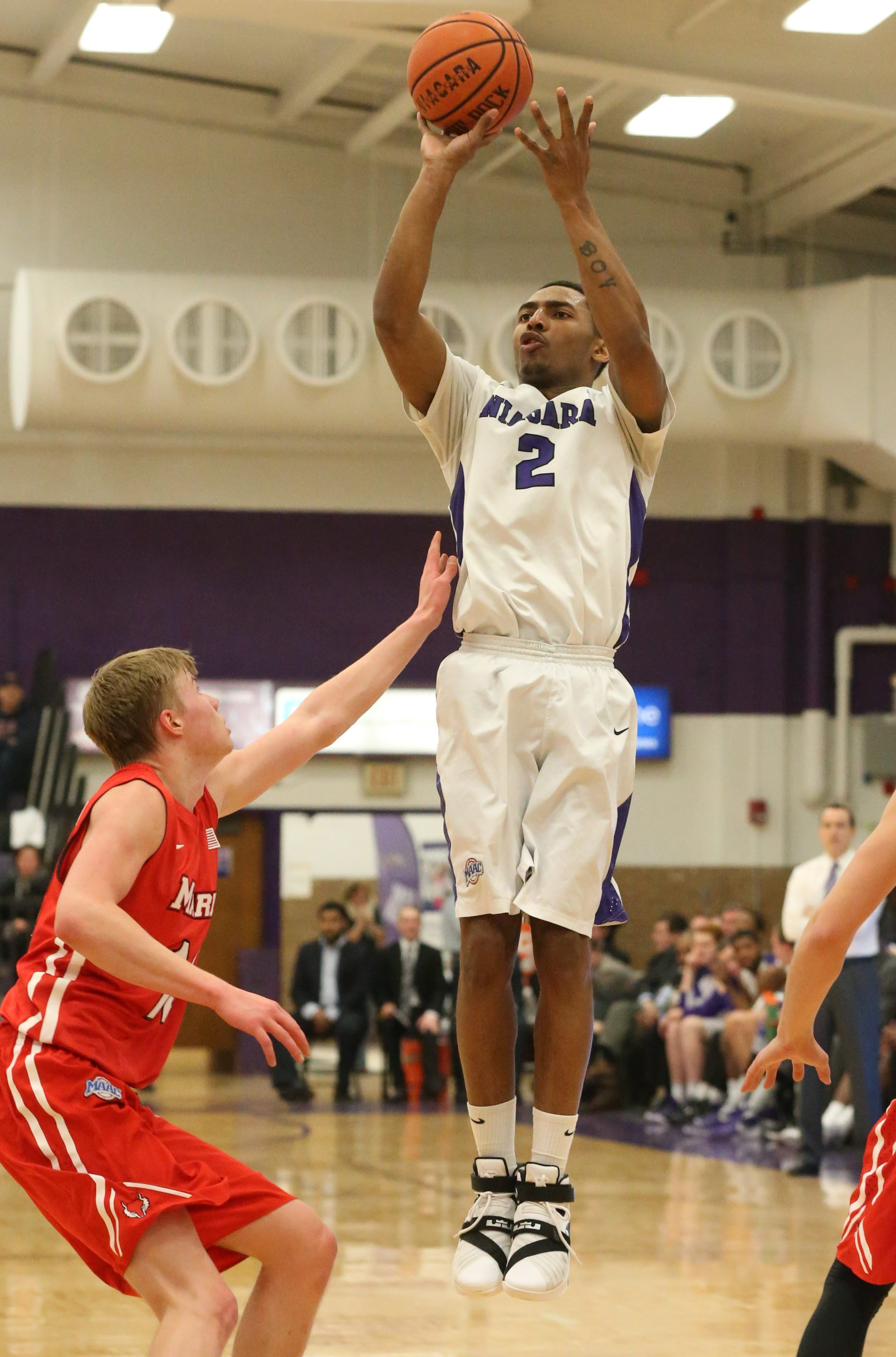 Niagara's Emile Blackman shoots over Marist's Kristinn Palsson in the first half at the Gallagher Center on Thursday.