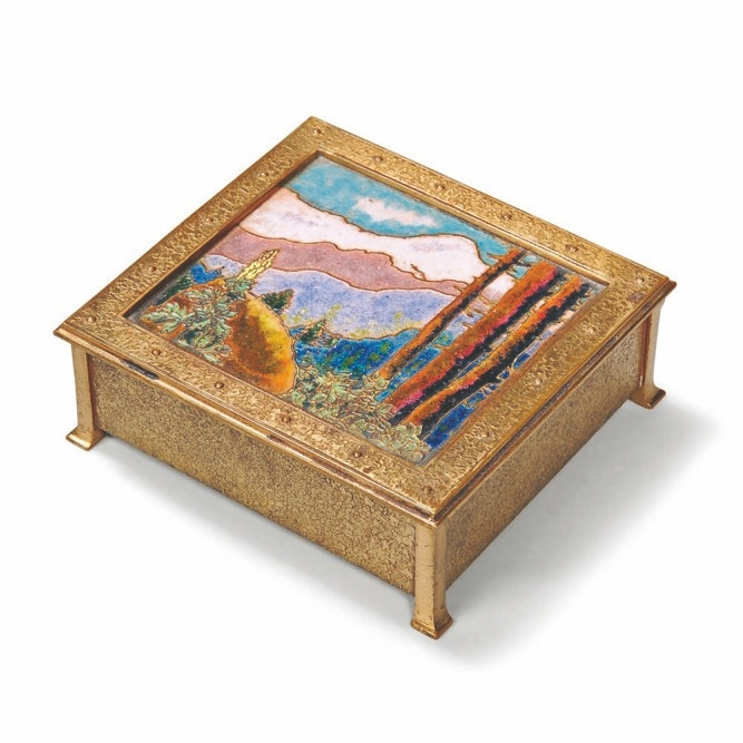 The landscape on this bronze box is enamel made from melted glass. It auctioned for $1,353, well over estimates.