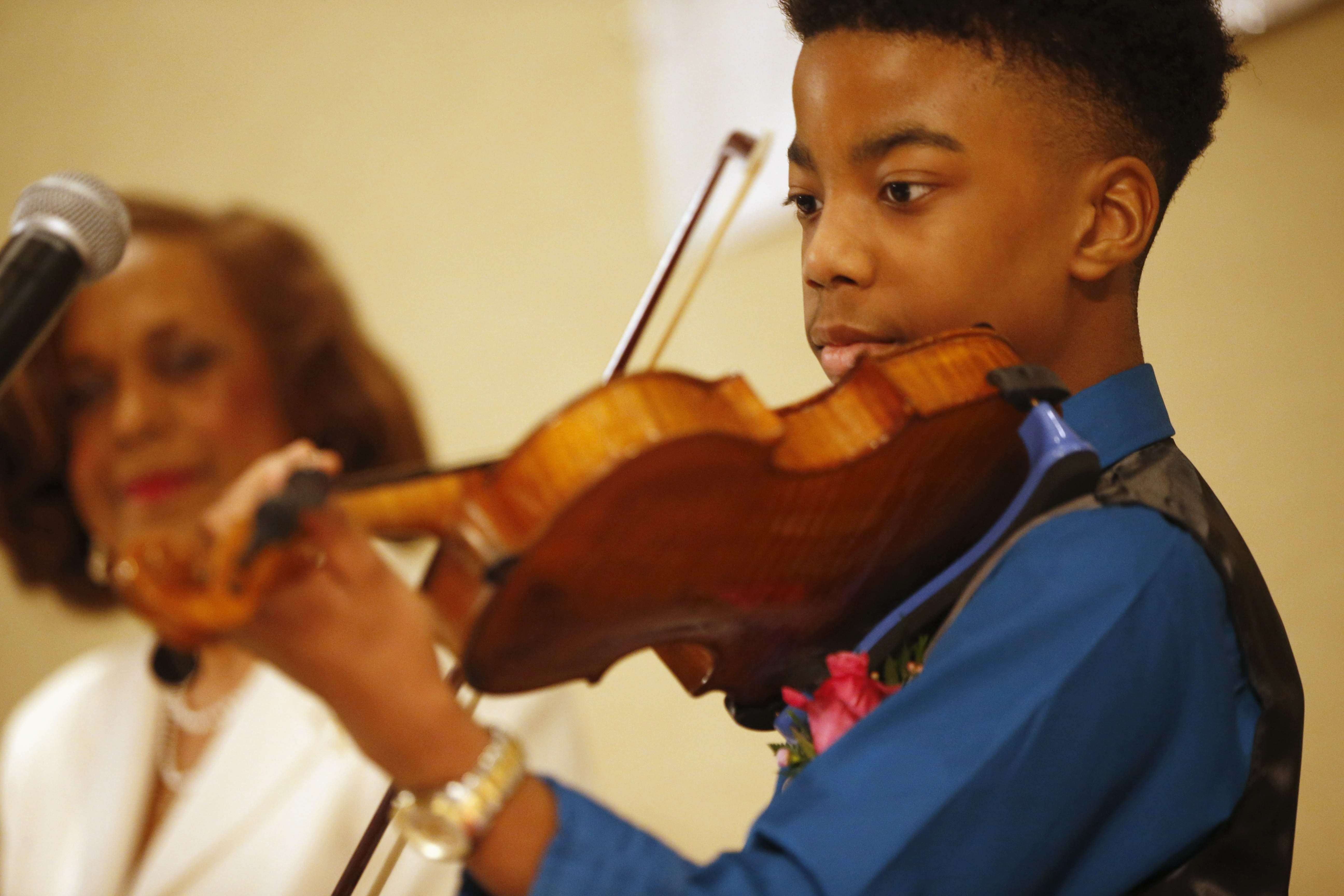 Rahim Dunston, one of four community service honorees, plays the violin at the Alpha Kappa Alpha Sorority, Xi Epsilon Omega Chapter Founder's Day Luncheon at the Buffalo Niagara Marriott on Sunday.