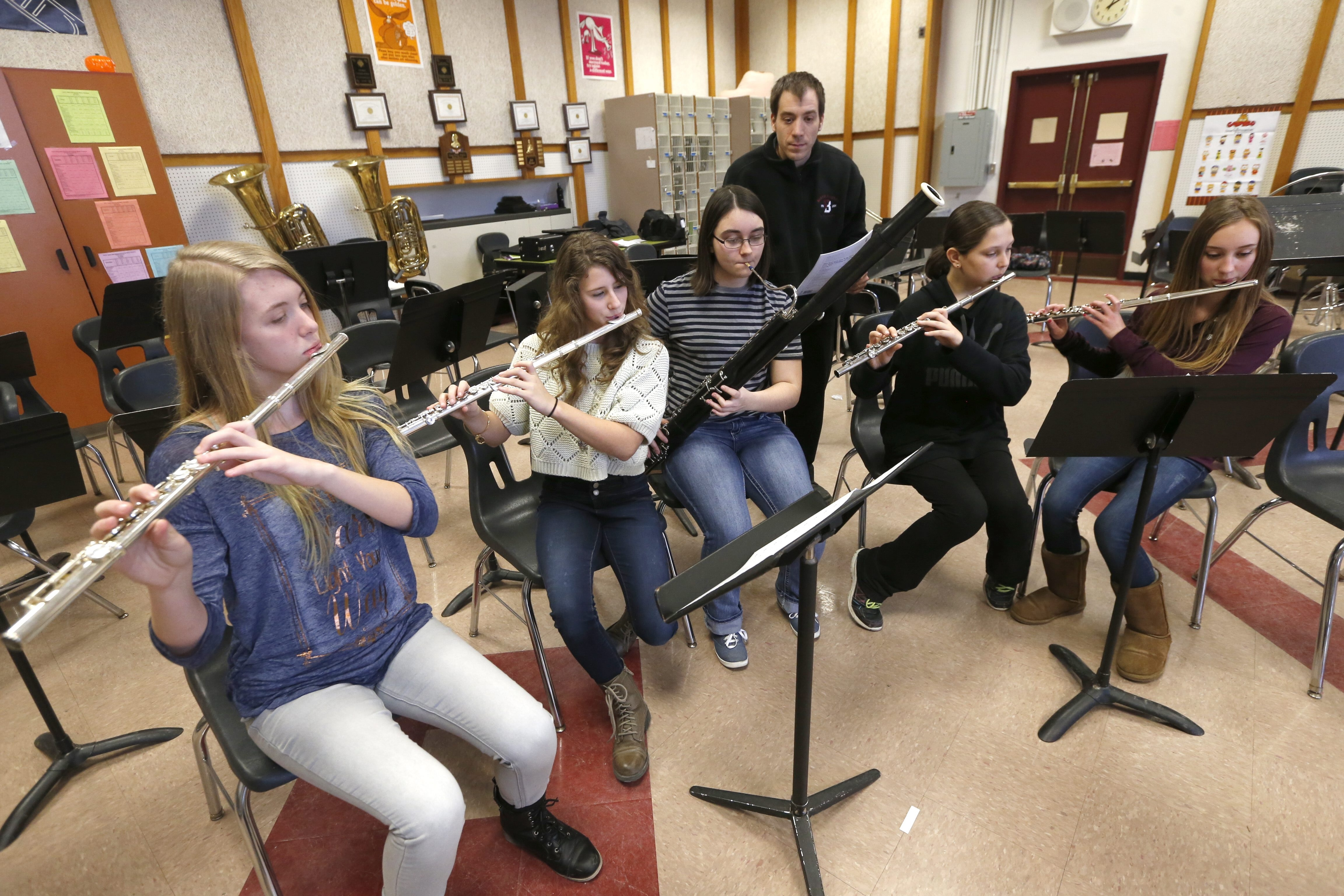 Music teacher Jeff Rappold works with students, from left, Jessalynn Coen, 13, Madison Gancasz, 12, Serena Flint, 16, Kazmira Hanel, 12, and Emma Rose, 13, at Barker High School recently.
