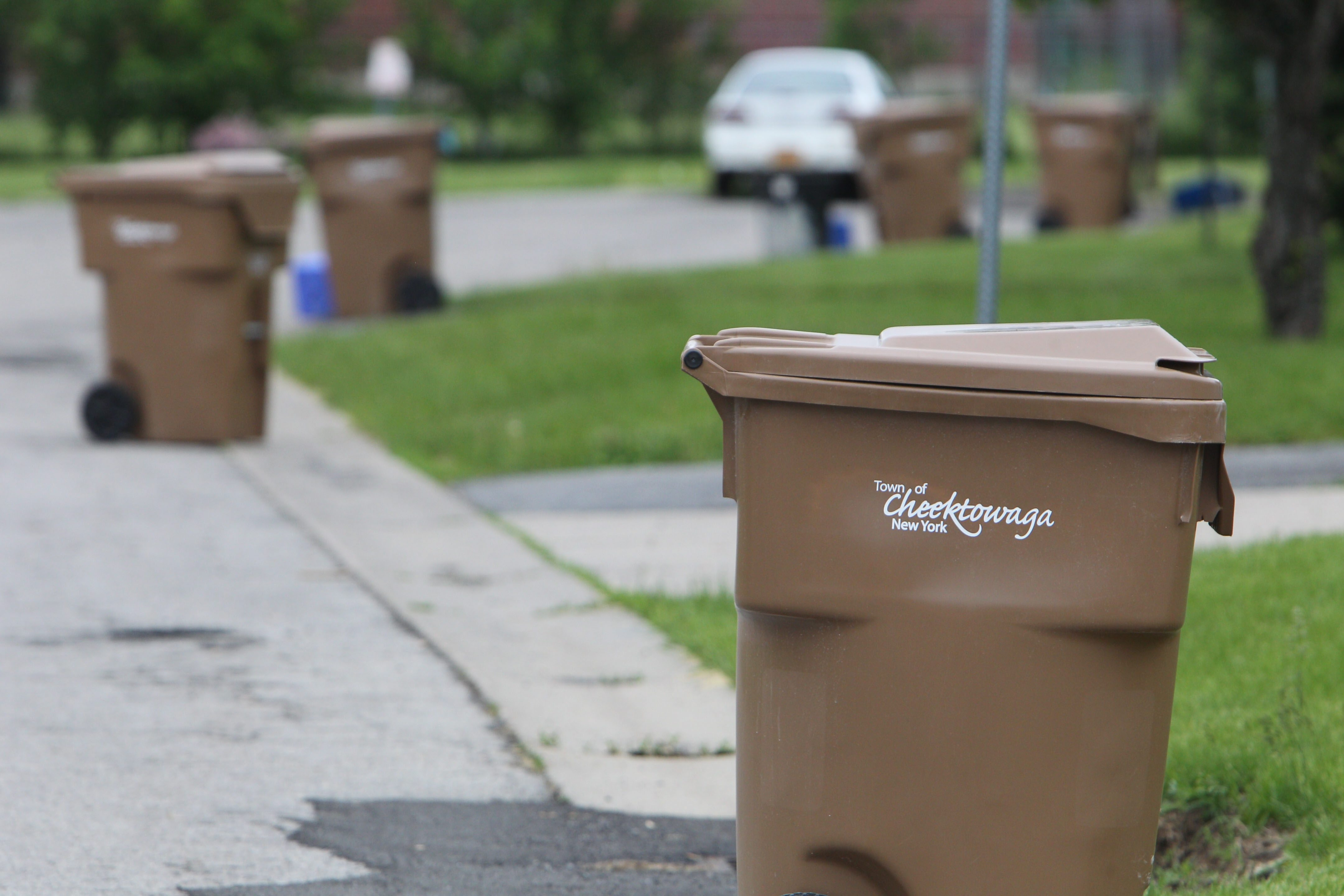 Cheektowaga is the latest of the first ring suburbs to start using the garbage totes.  They began using them last fall.  These are totes on garbage day on Kings Wood Dr., Friday, May 24, 2013.  (Sharon Cantillon/Buffalo News)