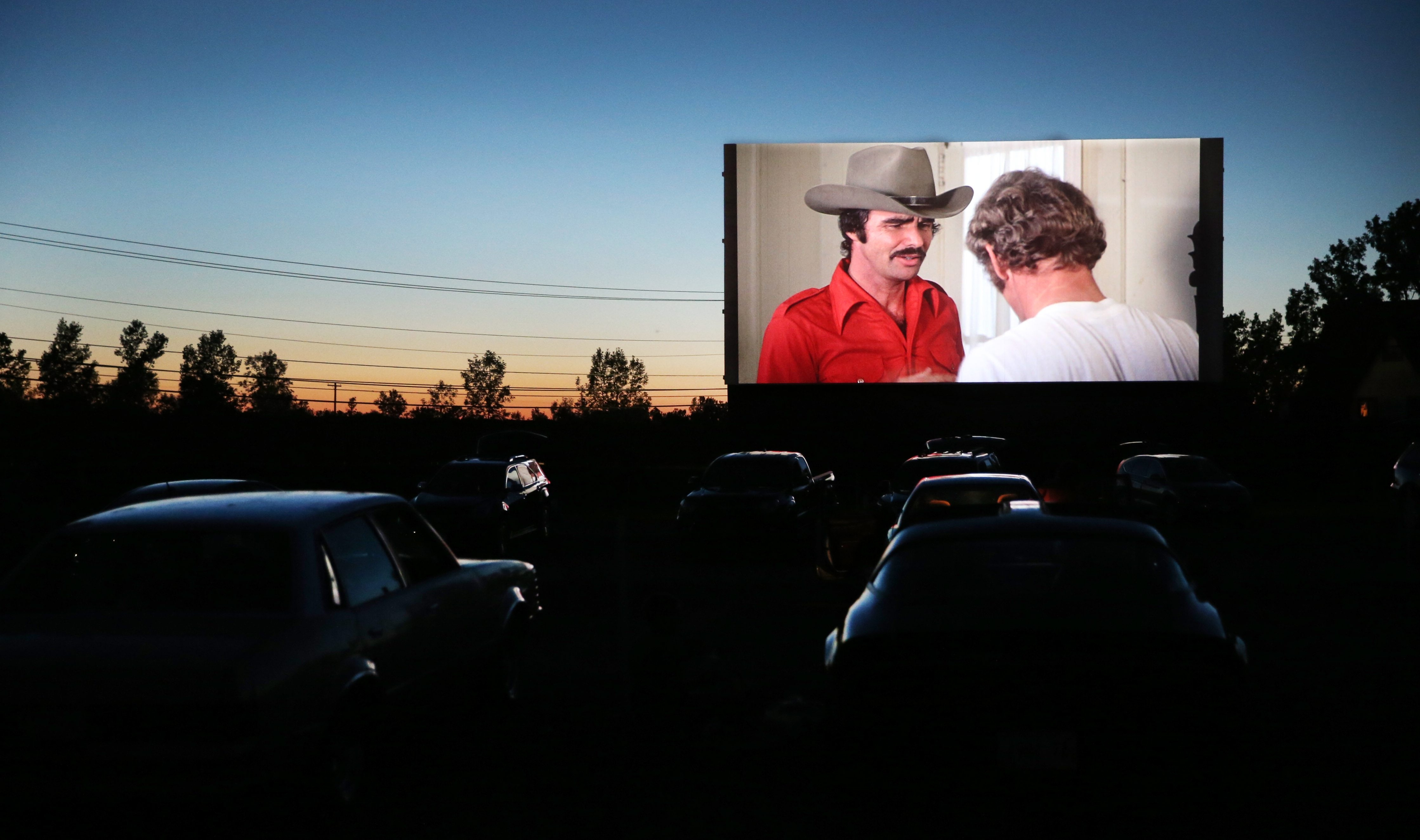 "Moviegoers watch ""Smokey and the Bandit"" on one of the four existing screens at Lockport's Transit Drive-In."