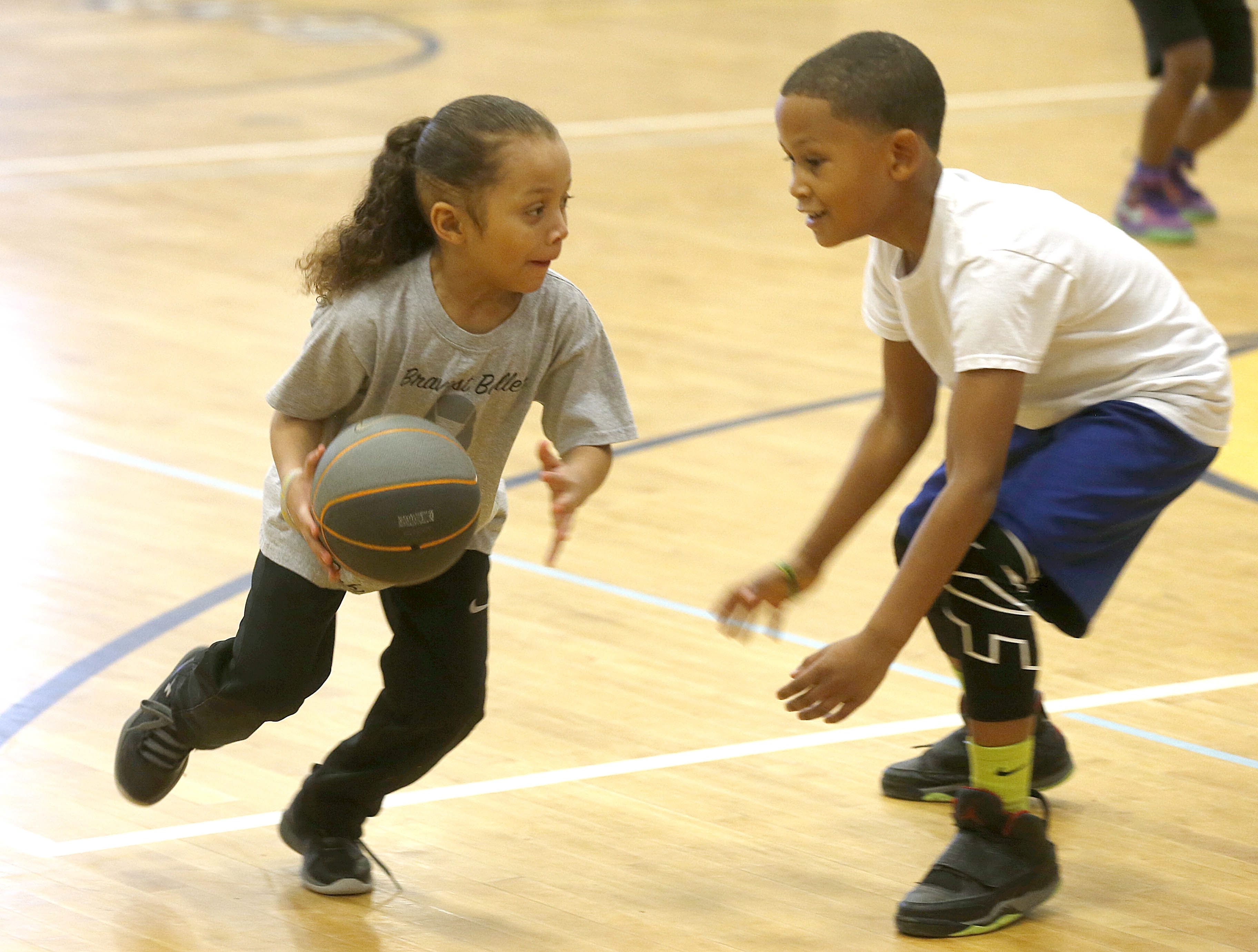 Shawn Kennedy, left, who suffers from a brain tumor, plays a little one-on-one Saturday.