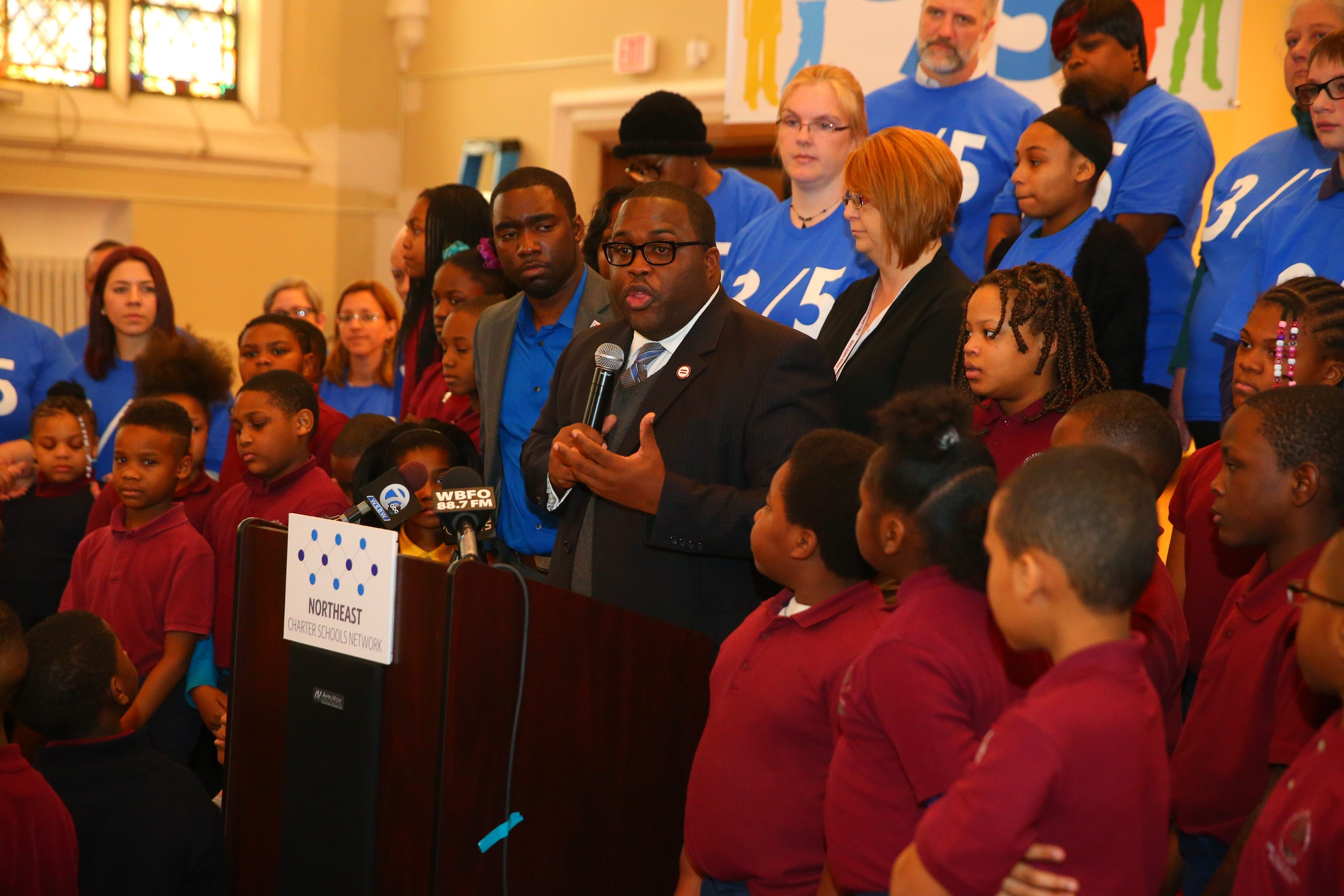 Vince Clark, vice president of the Buffalo Urban League, speaks Monday at the Charter School Day of Action, which featured parents, students and educators calling for more funding for charters.