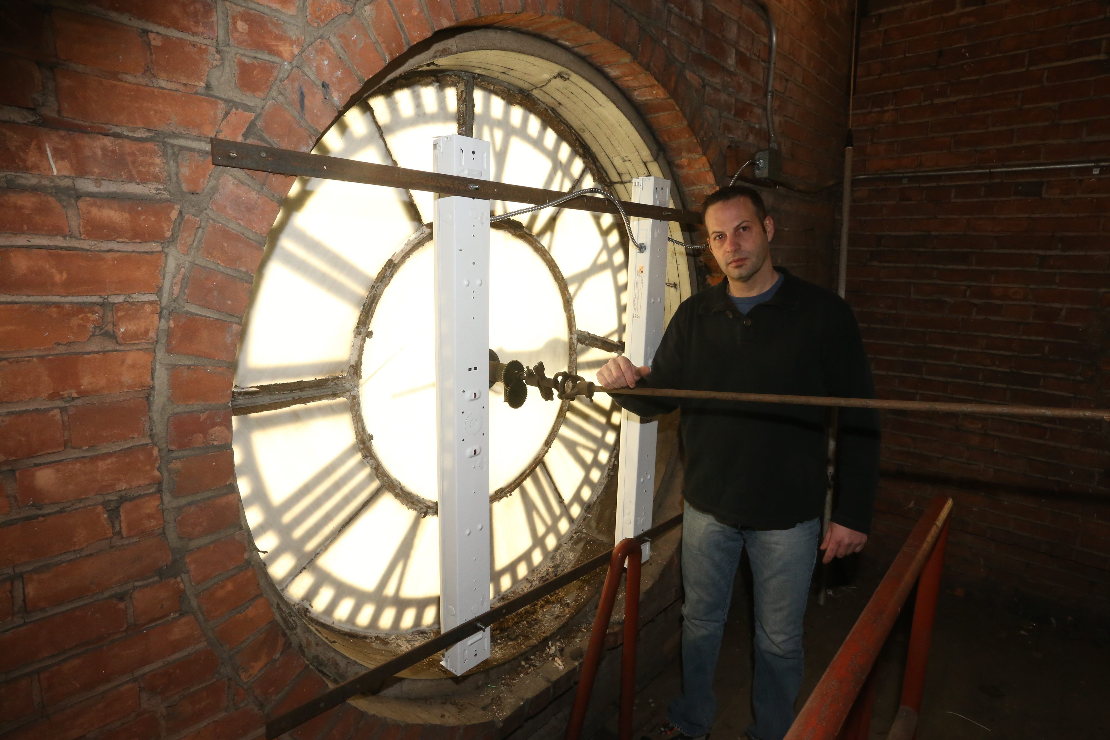 """Town's """"clock watcher,"""" in charge of the music, is parks/recreation laborer Carmen G. Ciccarelli, who programs a wide variety of songs."""