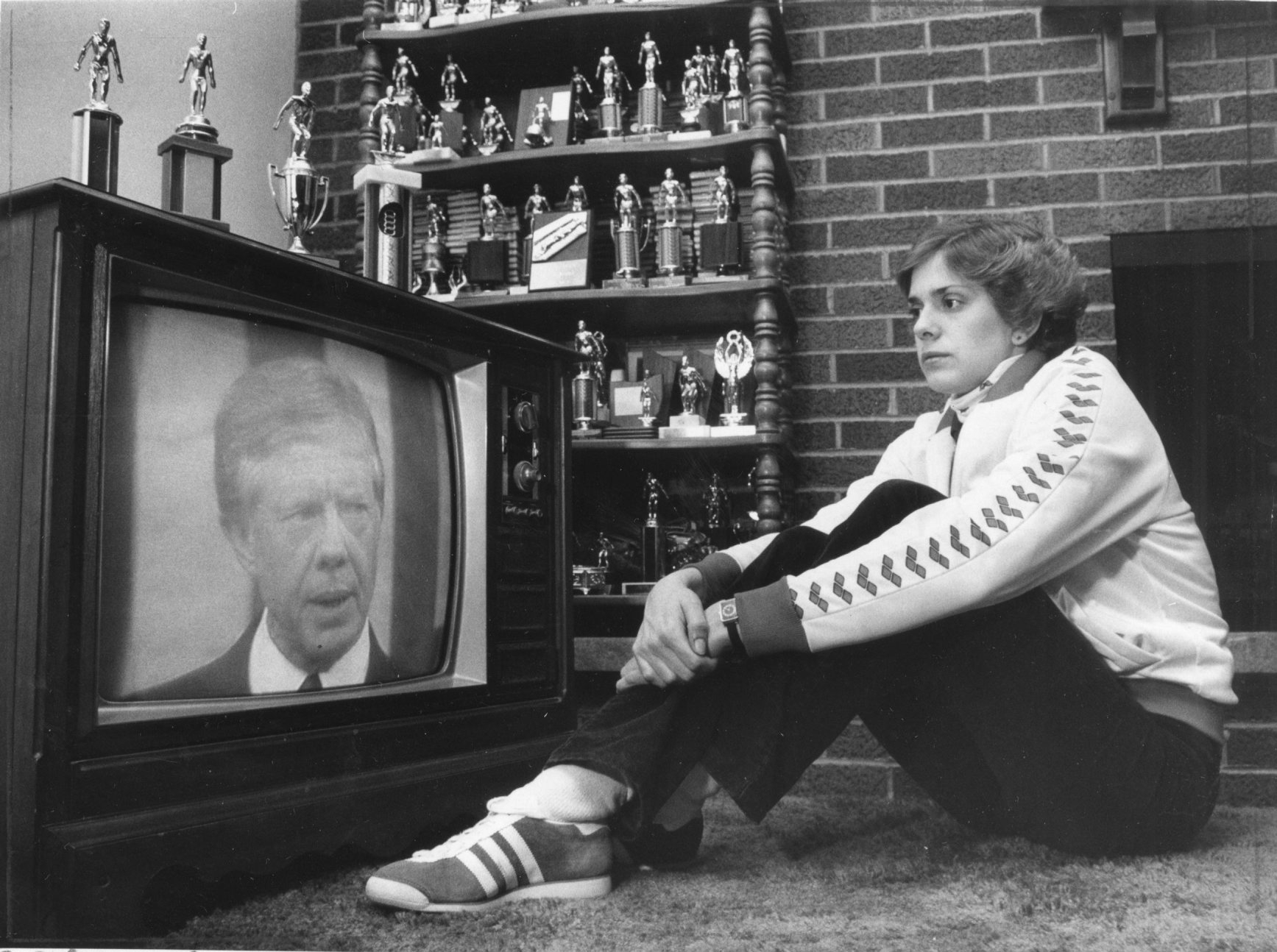 Sue Walsh listens to President Jimmy Carter announce that the United States is boycotting the 1980 Summer Games in Moscow.