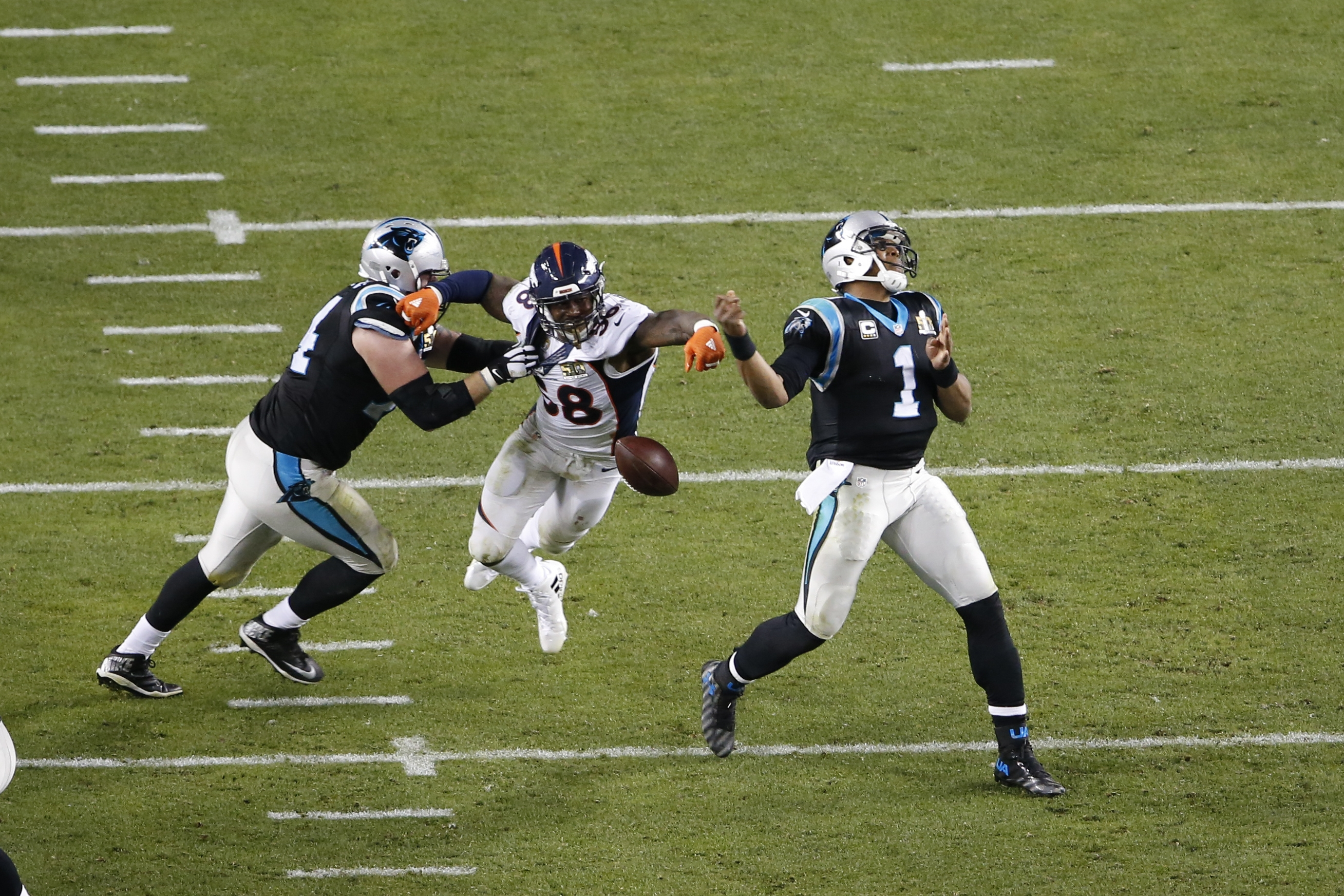 Denver Broncos linebacker Von Miller strips the ball from Carolina Panthers quarterback Cam Newton in the fourth quarter of Super Bowl 50.