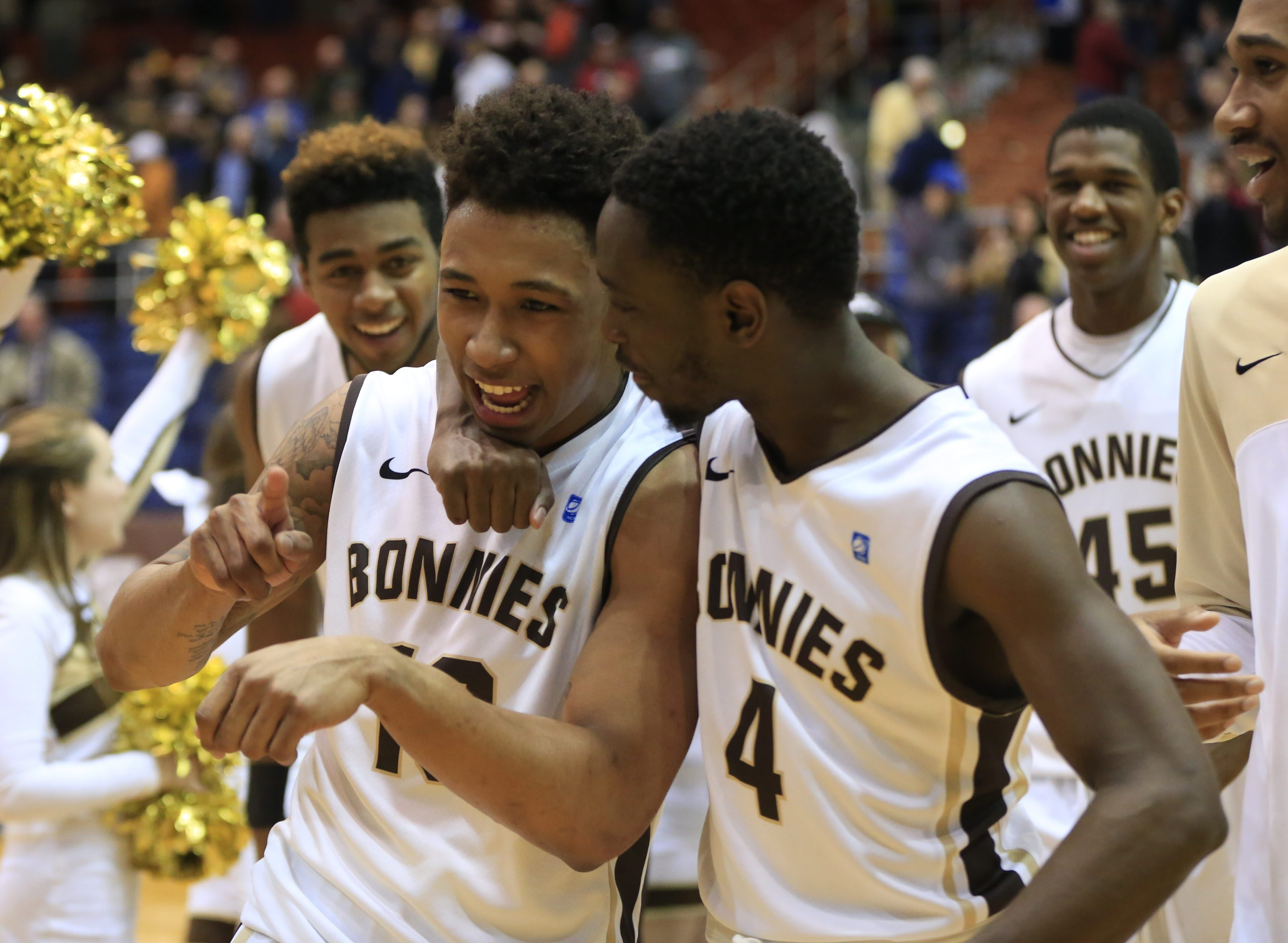 St. Bonaventure's Jaylen Adams, left, is congratulated by Nelson Kaputo after hitting a last-second three-point shot to beat Saint Louis on Sunday at the Reilly Center.
