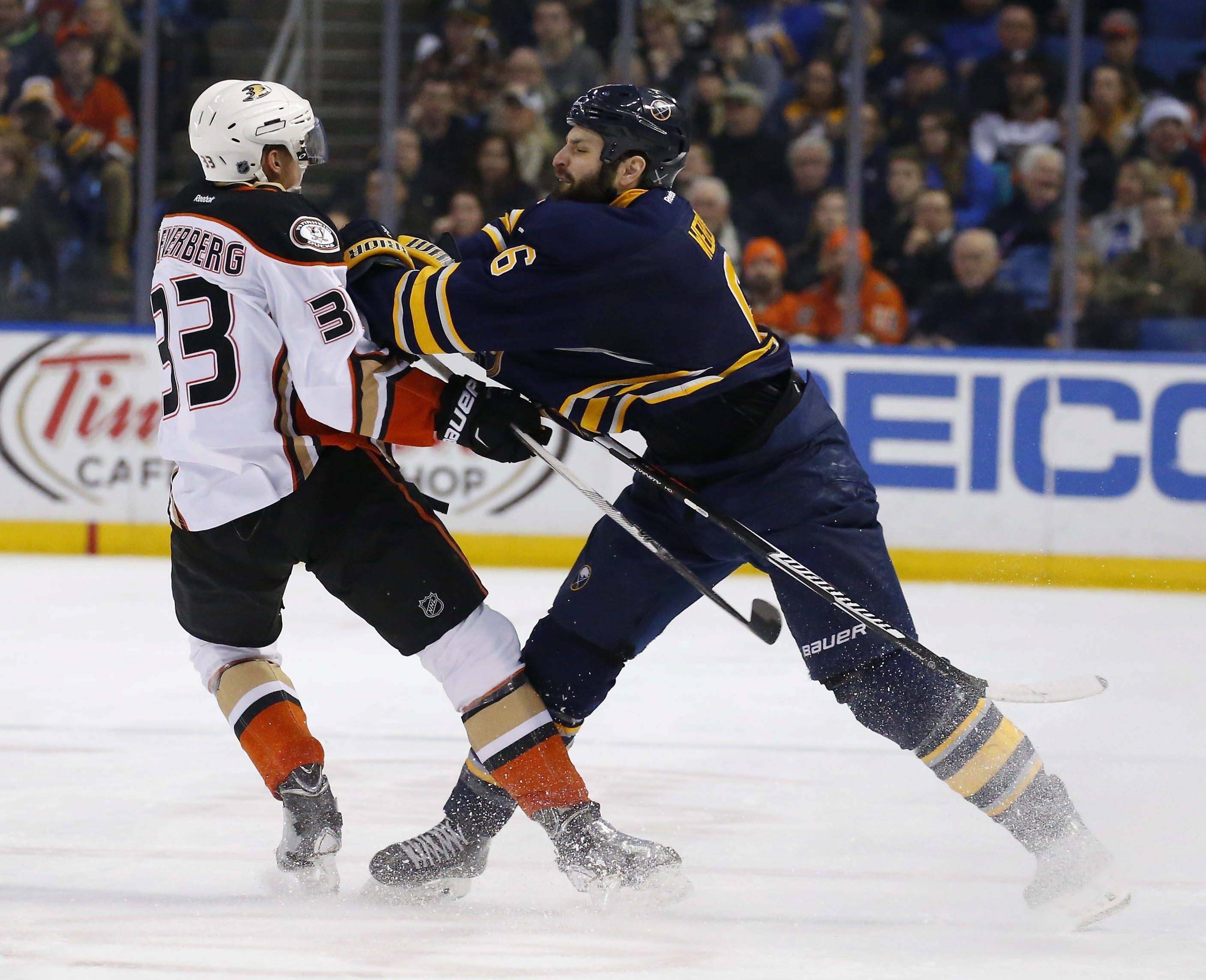 The Sabres' Mike Weber checks the Duck's Jakob Silfverberg in the first period at the First Niagara Center in BuffaloThursday, December 17, 2015.  (Mark Mulville/Buffalo News)