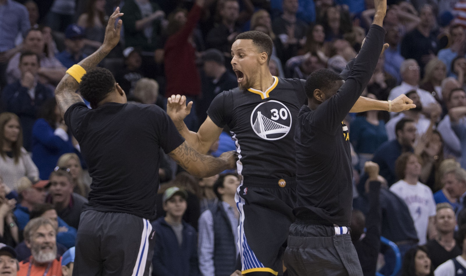 The Warriors' Stephen Curry celebrates after sinking the game-winning three-pointer against Oklahoma City in overtime on Saturday. (Getty Images)