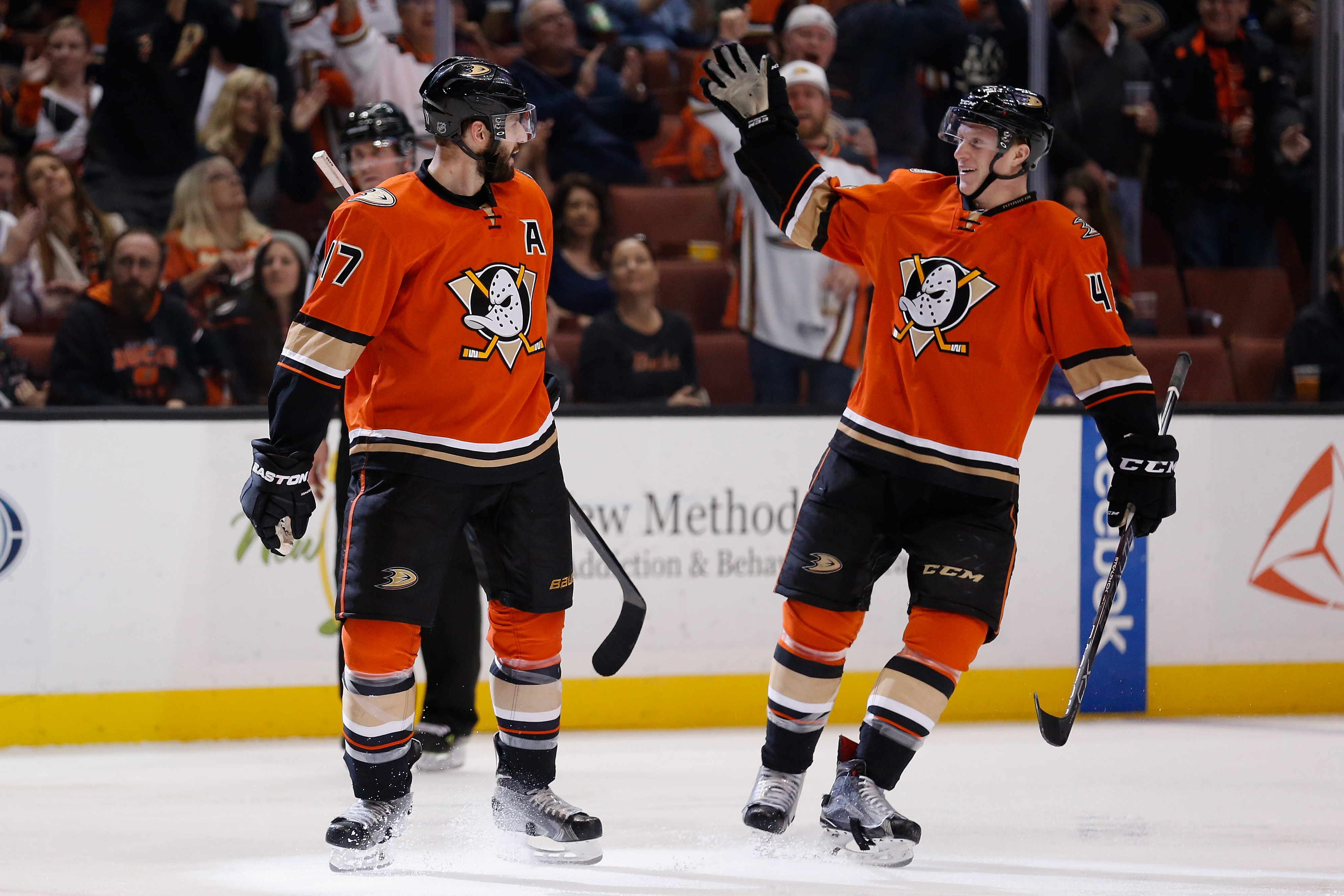 Ryan Kesler (17) and Josh Manson (42) celebrate one of the Ducks' goals in Sunday's 5-2 win over Calgary (Getty Images).