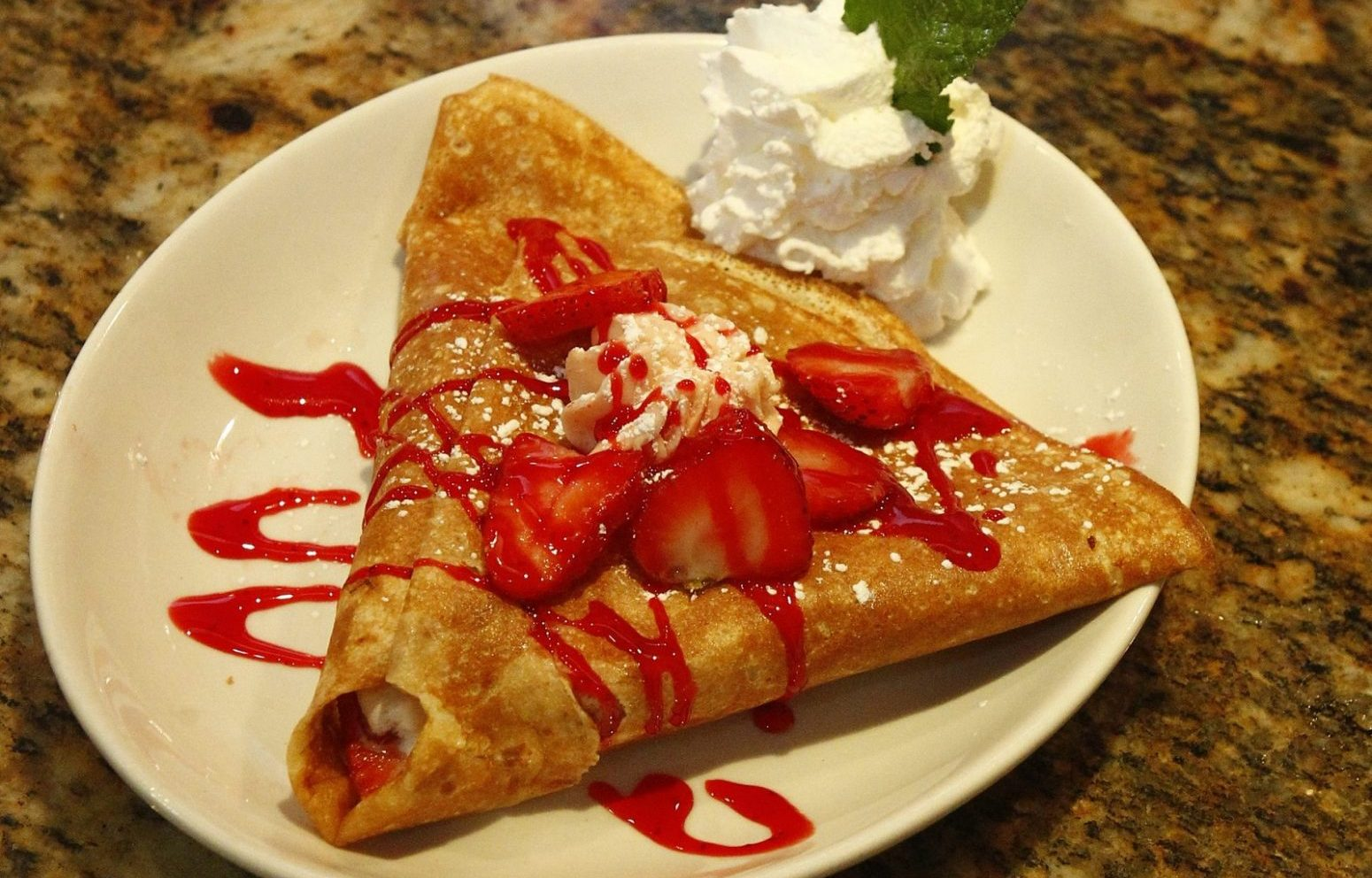 Strawberry Nutella crepe at Breakin' Eggs Creperie in Williamsville is one way to celebrate National Crepe Day. (John Hickey/Buffalo News file photo)