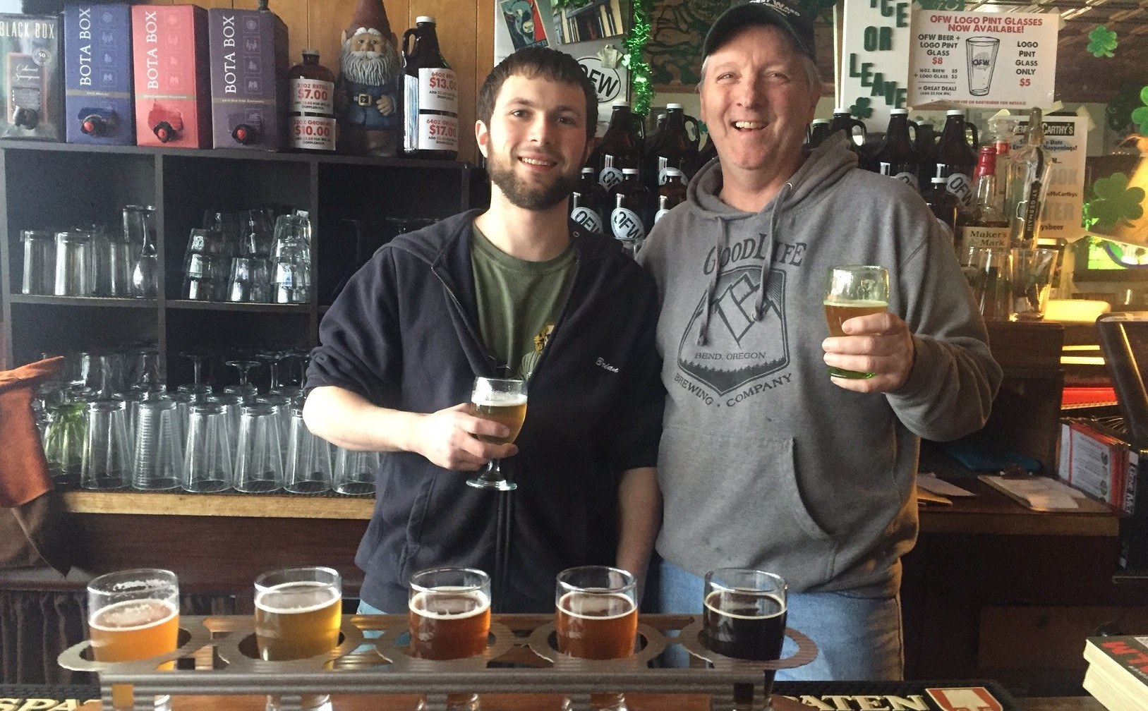 Bryan Kirchmyer and Bill Metzger hold beers at Gene McCarthy's and Old First Ward Brewing.