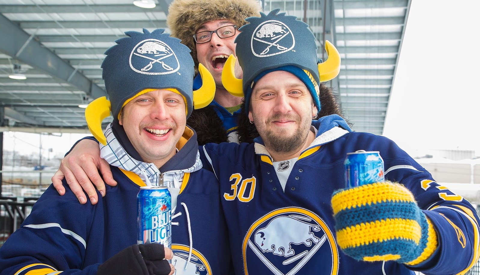 Sabres fans enjoy themselves at the 2015 Labatt Blue Pond Hockey Tournament in Buffalo RiverWorks. (Don Nieman/Special to The News)