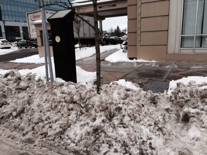 Tough scaling the snow mound this morning to pay the parking fee before getting a cup of coffee at Spot