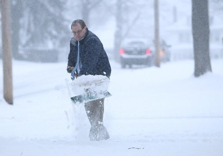 Throw snow forward when shoveling instead of twisting and turning. (Sharon Cantillon/Buffalo News file photo)