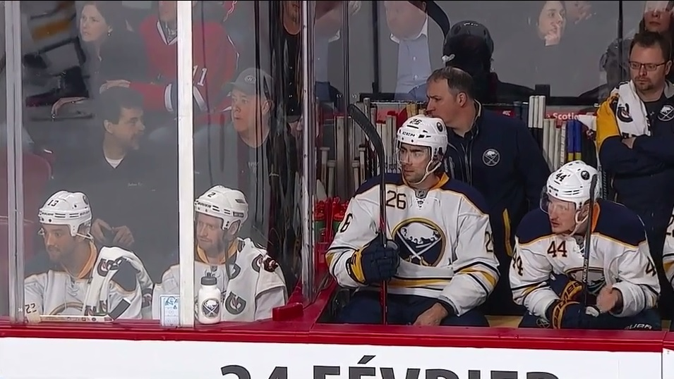 Canadian TV personality Wilder Weir (left) and his friend look the part as Sabres -- next to the actual bench. (from Streamable video)