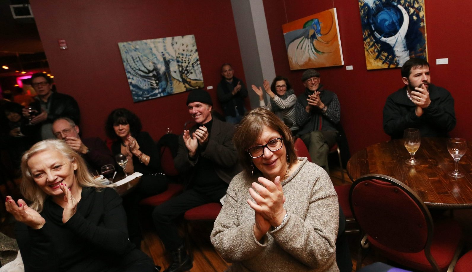 Art hangs from the walls of Pausa Art House during a show in January. (Sharon Cantillon/Buffalo News)