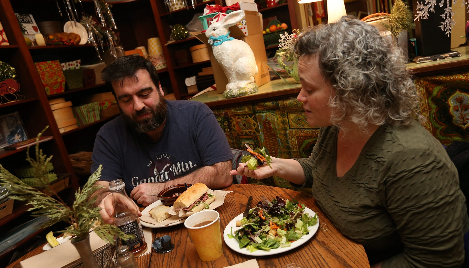 The Globe Market Elmwood regulars Philip and Wendy Mistretta, of Buffalo, have lunch. (Sharon Cantillon/Buffalo News)