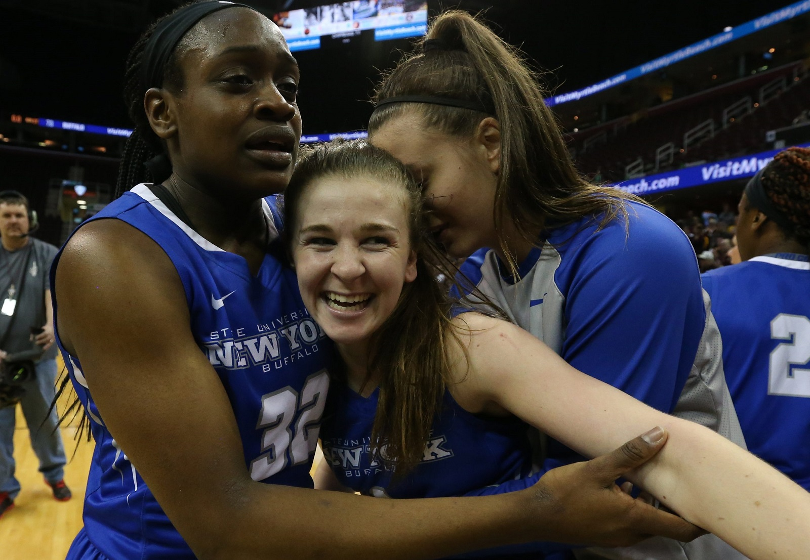 UB guard Stephanie Reid, middle, celebrates after knocking down a buzzer-beater to clinch a trip to the NCAA Tournament. (James P. McCoy/ Buffalo News)