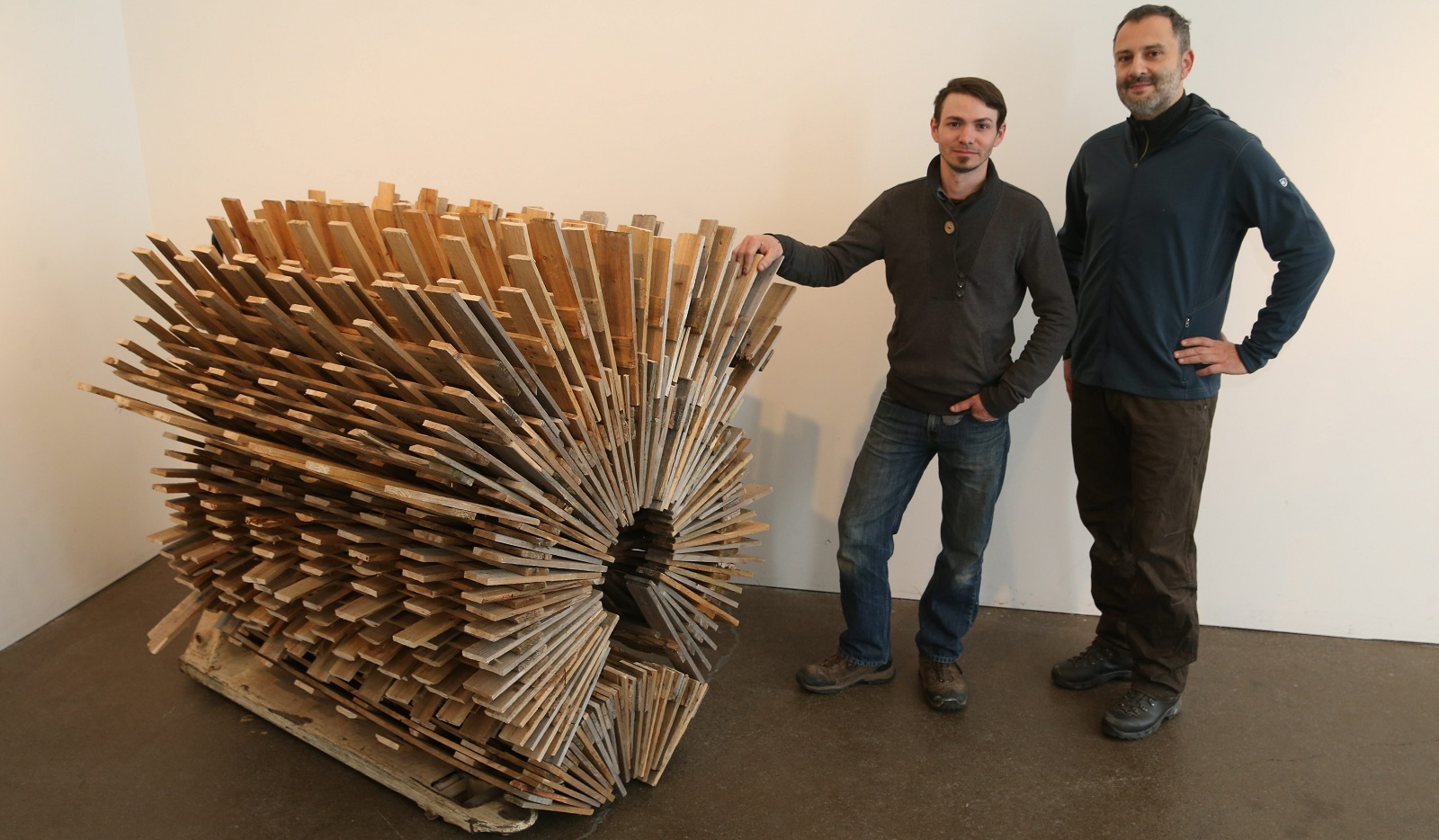 Local artist Scott Bye and Eleven Twenty Projects Gallery owner John Fatta stand near Bye's work. (Sharon Cantillon/Buffalo News)