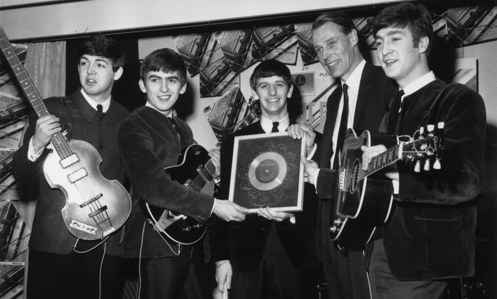 Beatles Producer George Martin in April 1963 with The Beatles. (Photo by Chris Ware/Keystone/Getty Images)