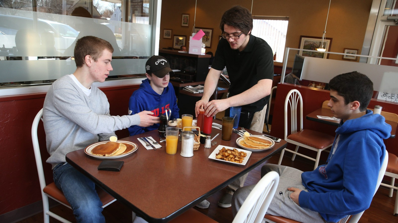 Sam Aures serves Ryan Dils, left, Tyler Ahearn and Jacob Hangen of Hamburg at ZJ's Family Restaurant, 140 Pine St., Hamburg. See a photo gallery at galleries.buffalonews.com.