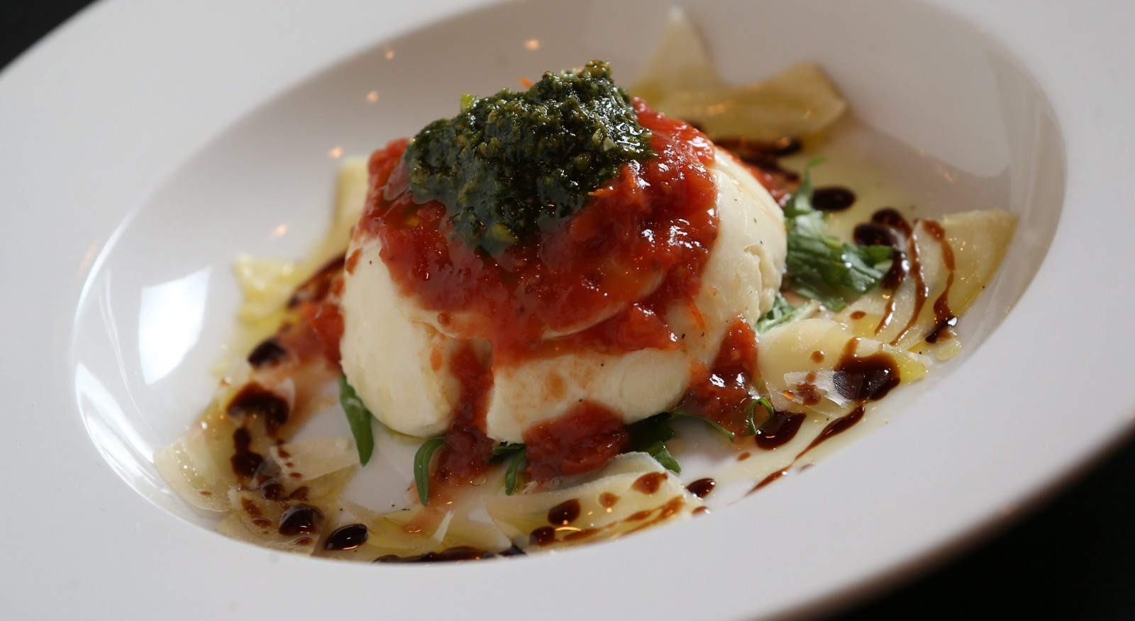 House-made stuffed mozzarella and ricotta, tomato jam and pistachio pesto from Cipollina. (Sharon Cantillon/Buffalo News)