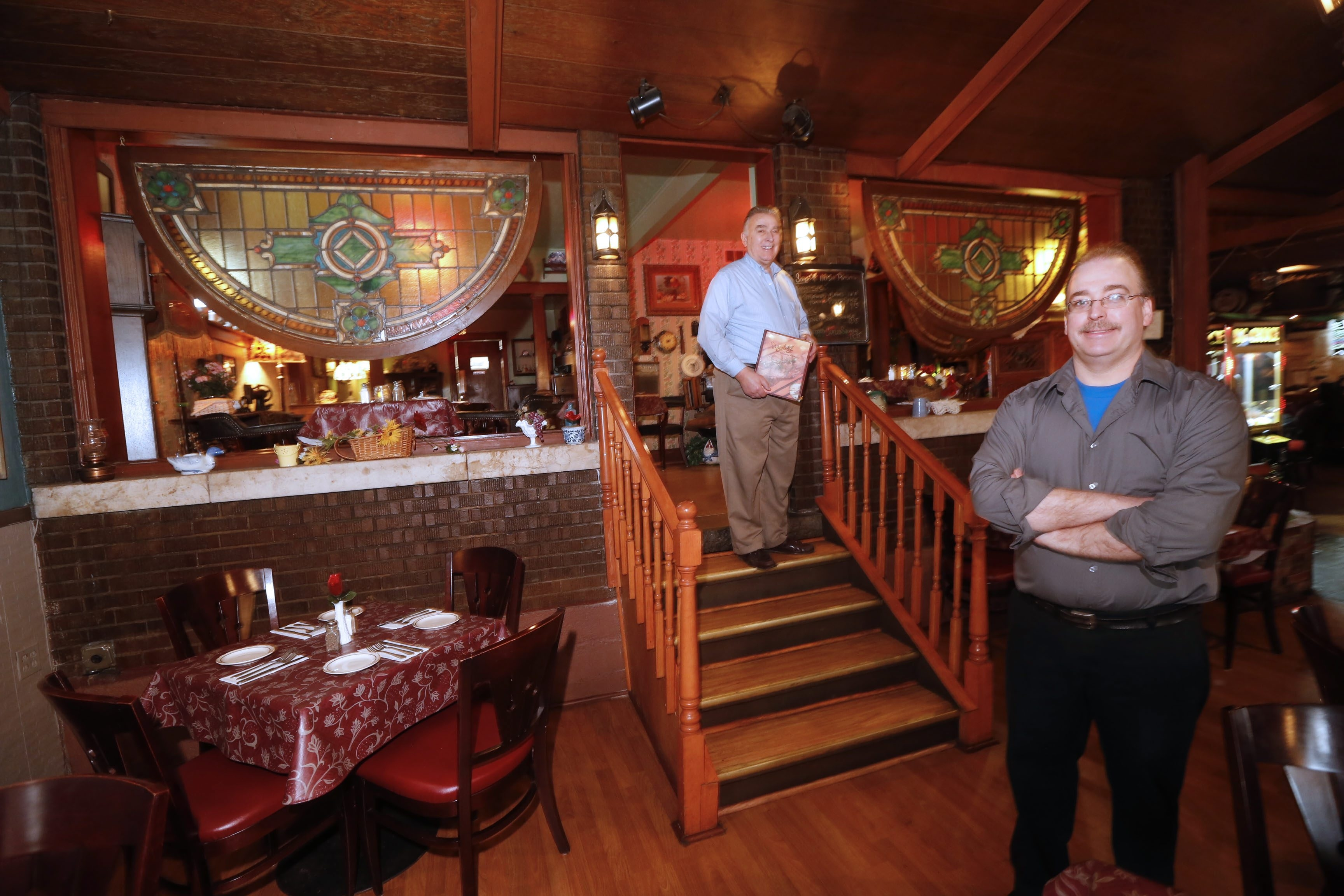 Owners Kevin Young, left, and David Young stand amid the homey ambience of the Bakery Restaurant and Lounge, which conjures up a turn of the century feel.