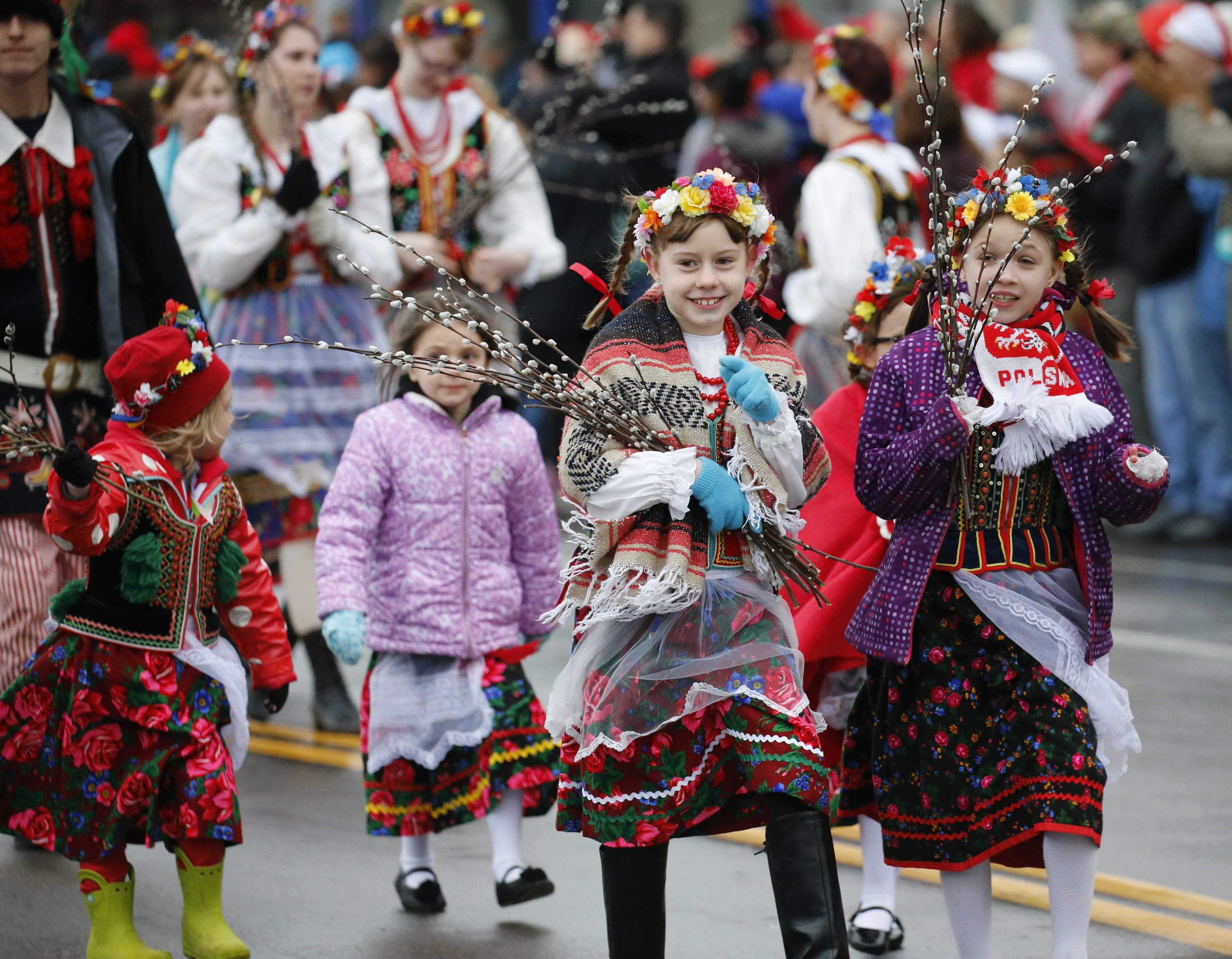 df620a7b7927 Armed with pussy willows, revelers in traditional Polish dress march Monday  in the Dyngus Day