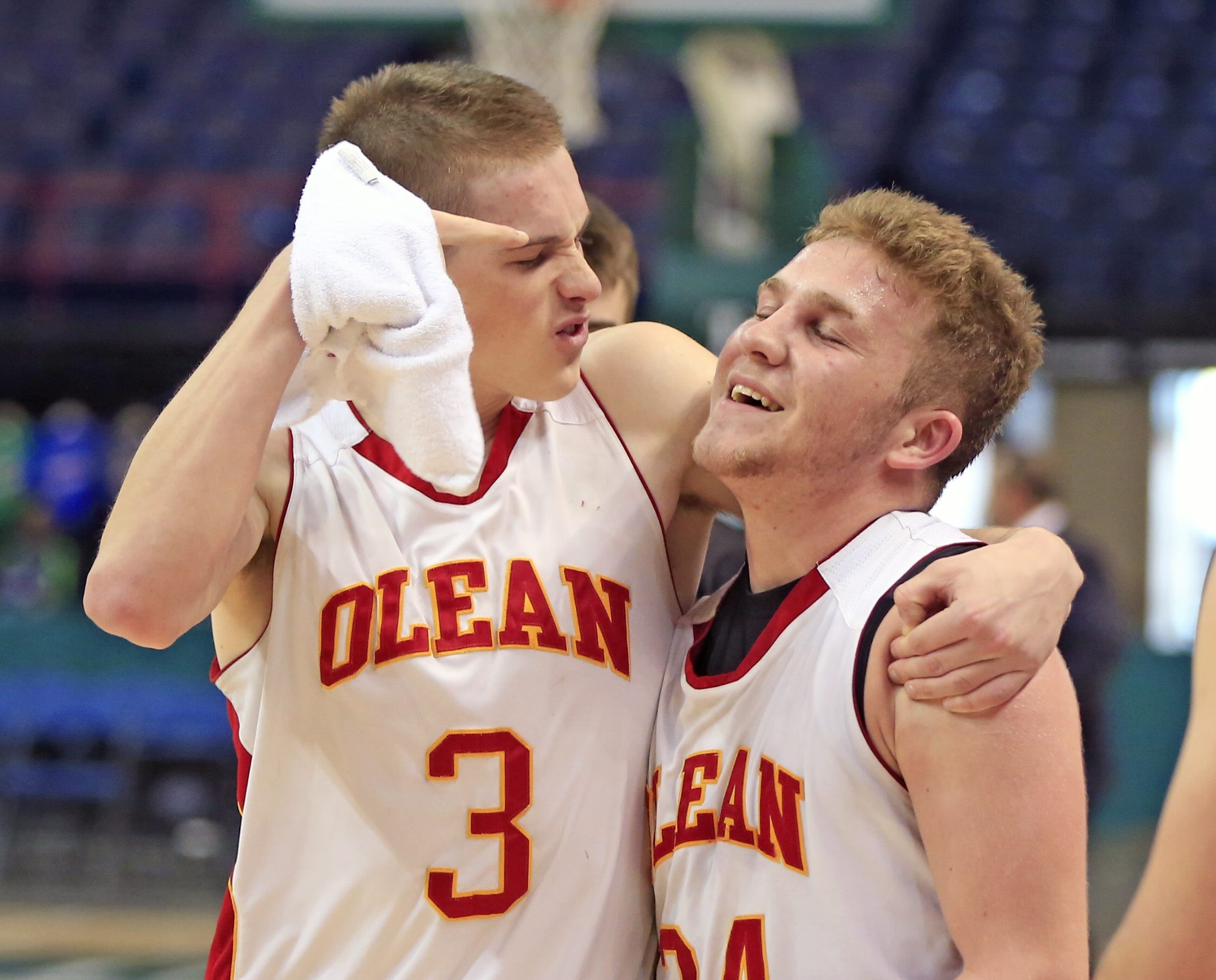 Olean's Derek Schmidt, left, celebrates with Jacob Cavana, who made two free throws with less than a second left.