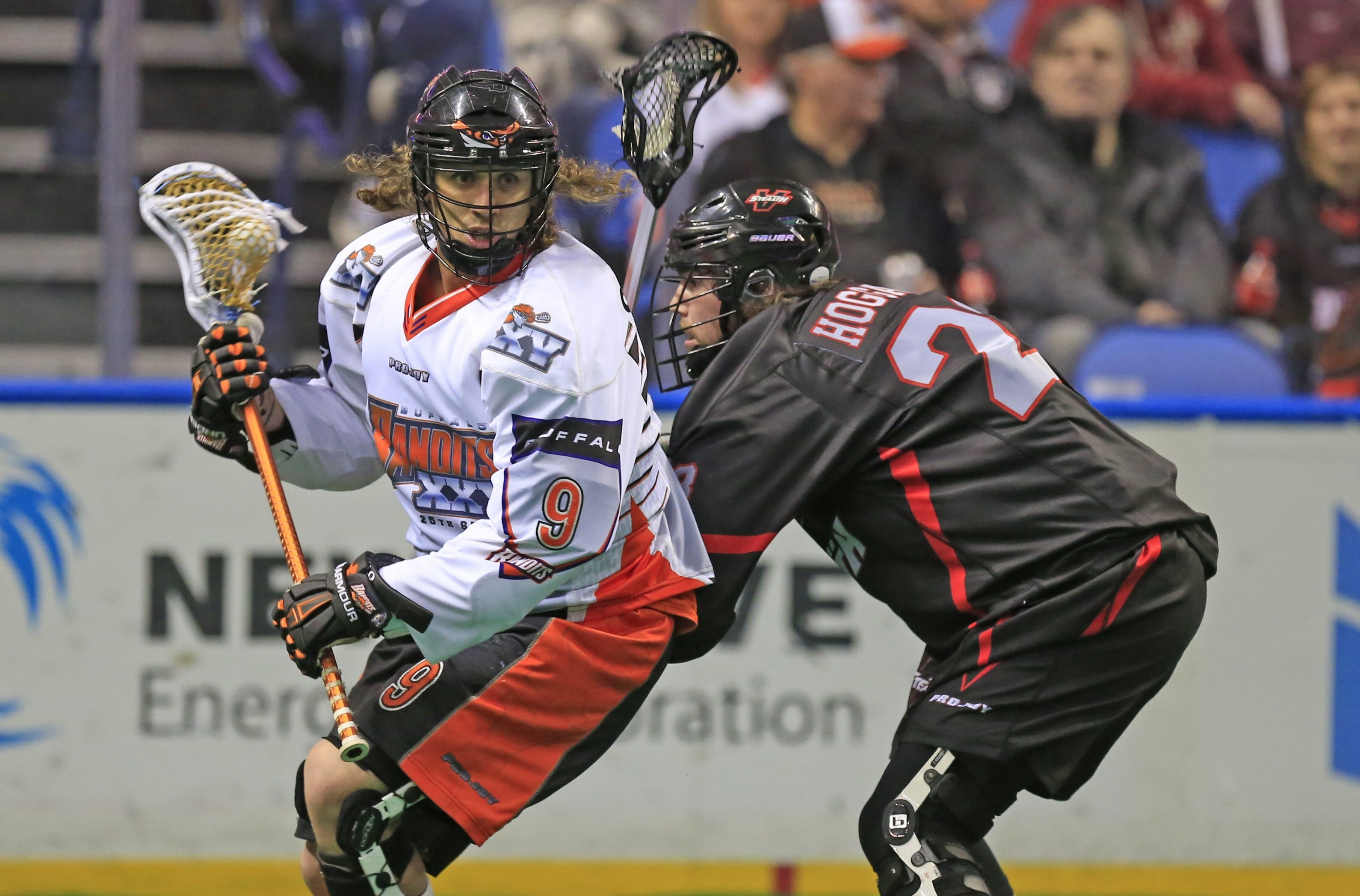 The Bandits' Mark Steenhuis works around Vancouver's Thomas Hoggarth during action at First Niagara Center.