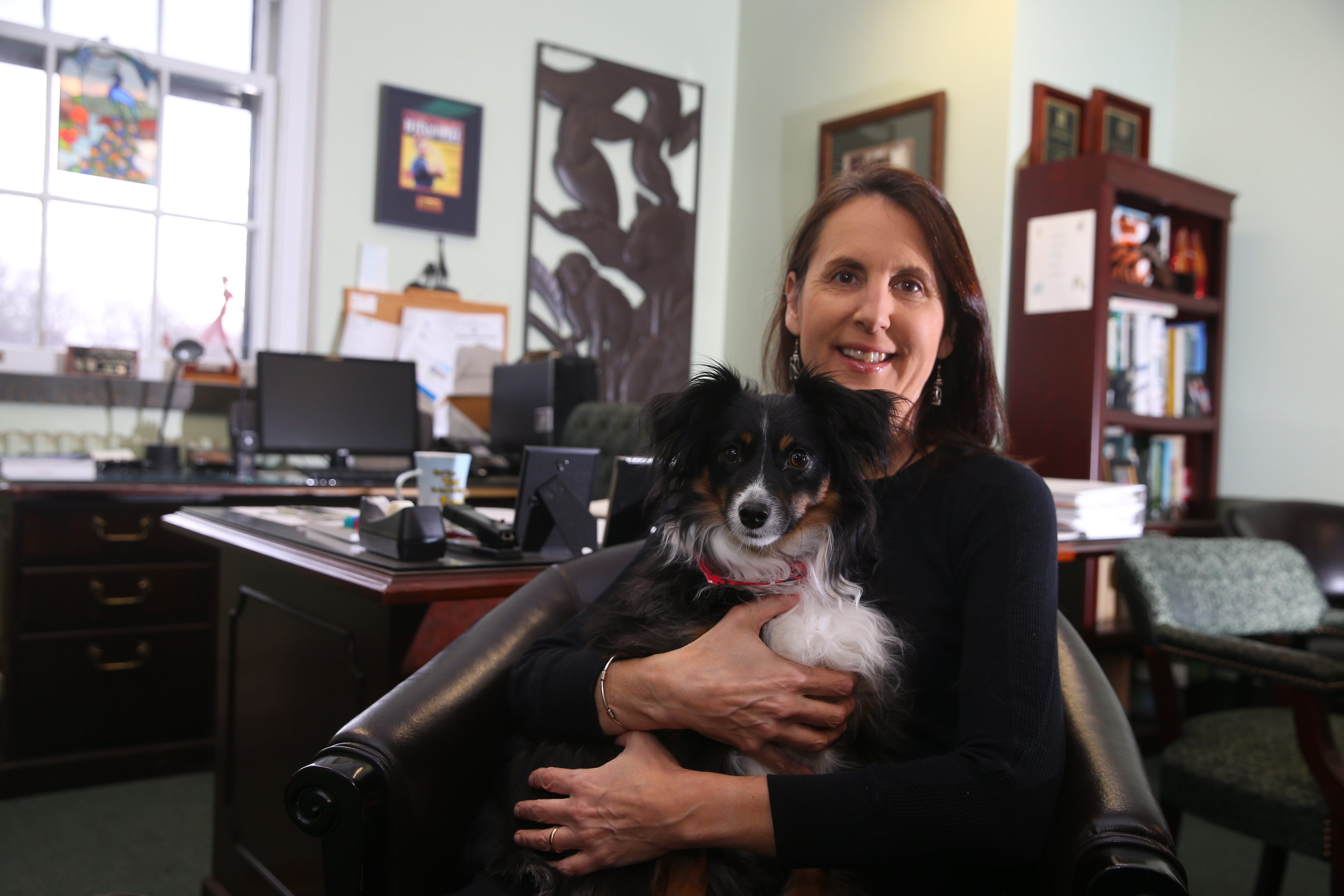 President Donna Fernandes, with her dog Darcy, has led the way in transforming the exhibits at the Buffalo Zoo, the nation's third-oldest.