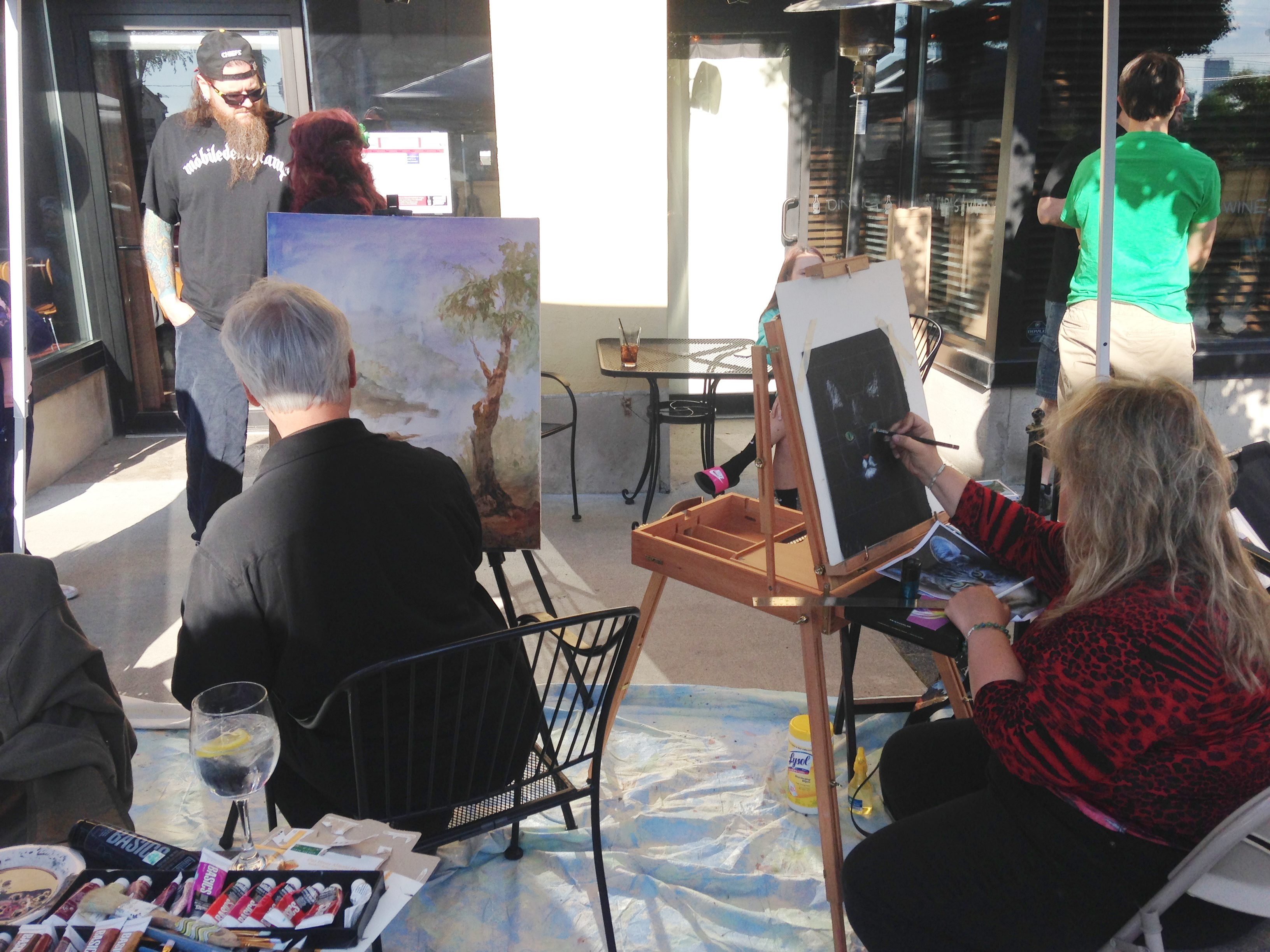 "Artists at work last summer at one of the ""Paint Outs,"" where they created pieces that will be auctioned April 10 at Wine on Third in Niagara Falls."