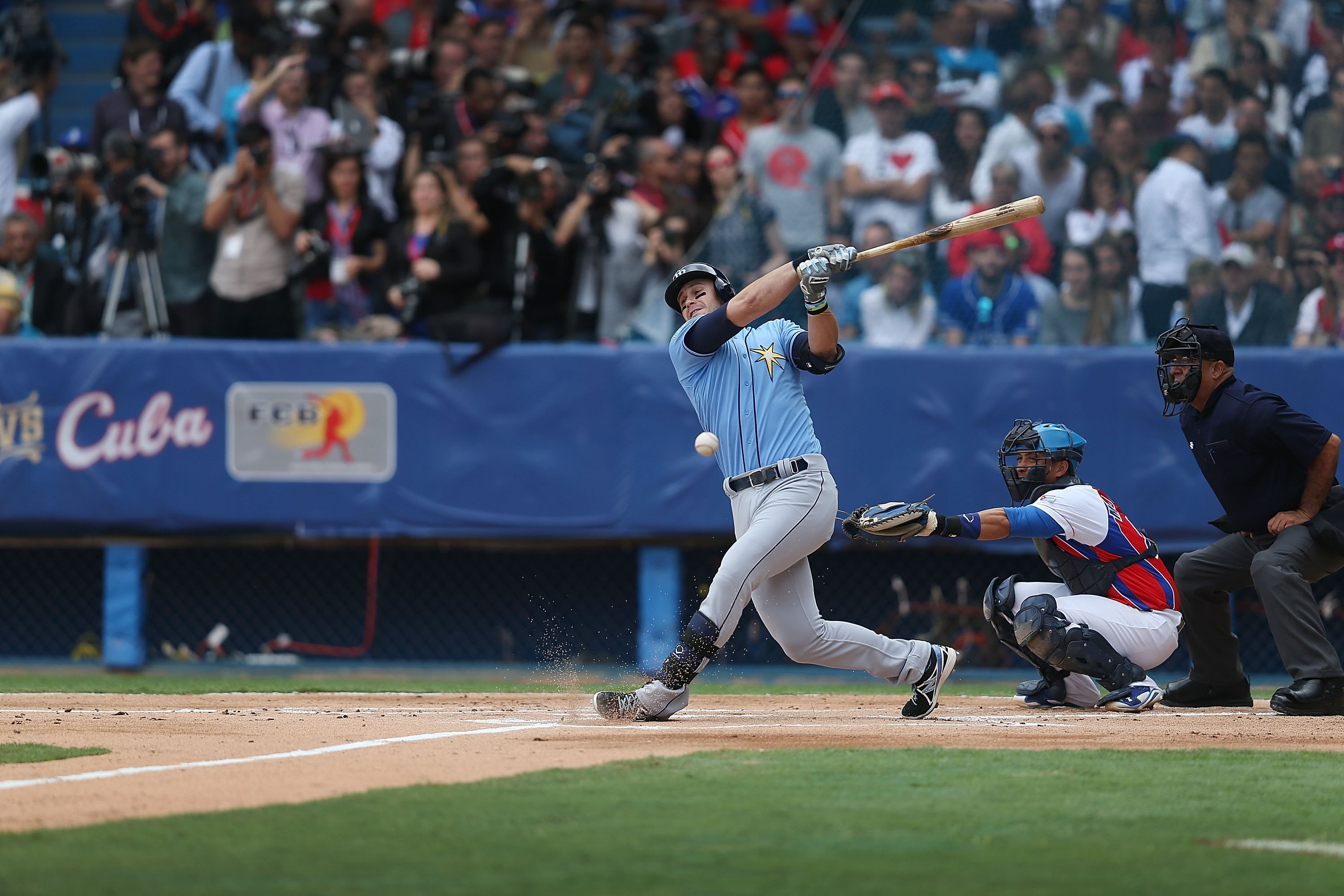 Tampa Bay's Dayron Varona, who defected from Cuba in 2013, takes a swing during the exhibition game between the Cuban national team and the Rays Tuesday in Havana.