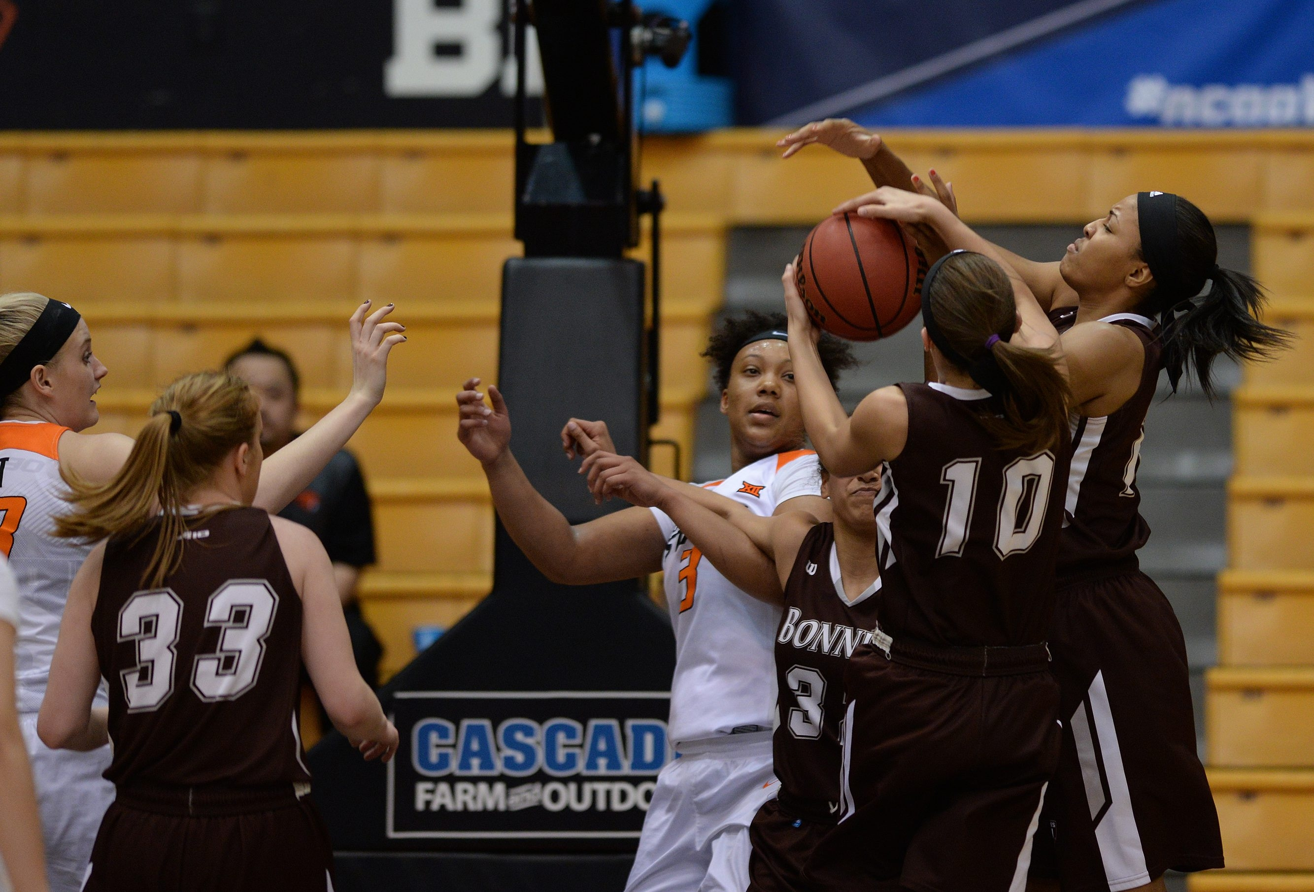 Mckenna Maycock (10) and forward Gabby Richmond made sure St. Bonaventure got a key rebound against Oklahoma State.