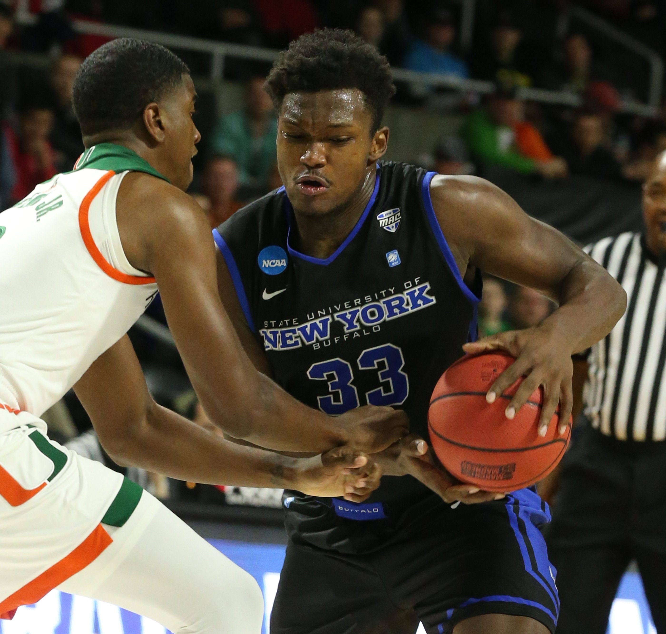Freshman forward Nick Perkins scores two of his career-high 20 points in the first half of UB's NCAA loss to Miami.