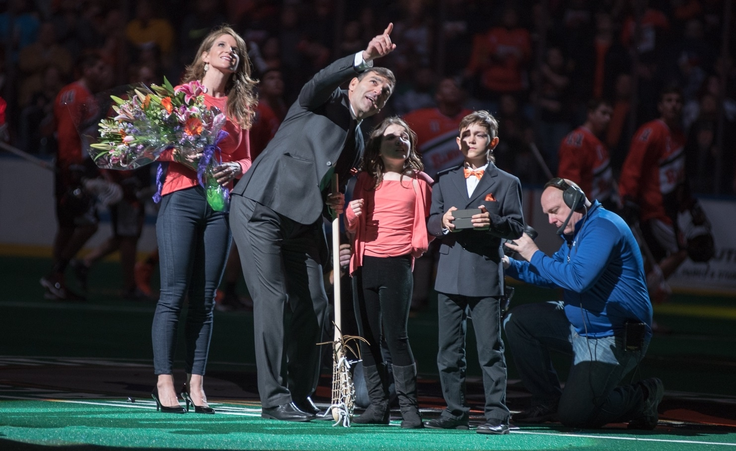 Bandits legend John Tavares and his family watch as the superstar's No. 11 is raised to the rafters on March 11, 2016 in the First Niagara Center. (Matt Weinberg/Special to The News)