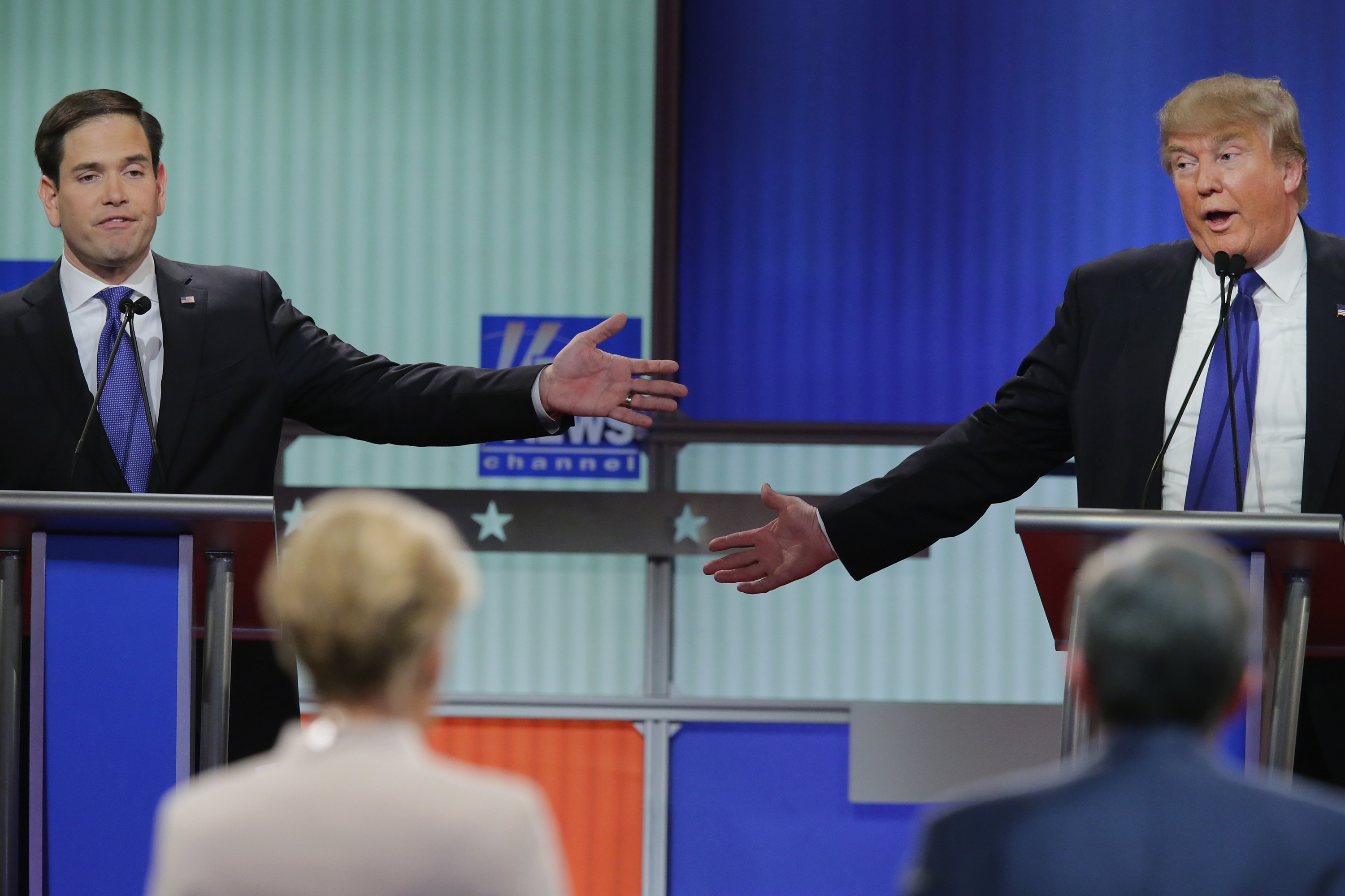 Republican presidential candidates Sen. Marco Rubio, left, and Donald Trump square off during last week's debate in Detroit. Michigan voters head to the polls Tuesday for the state primary.