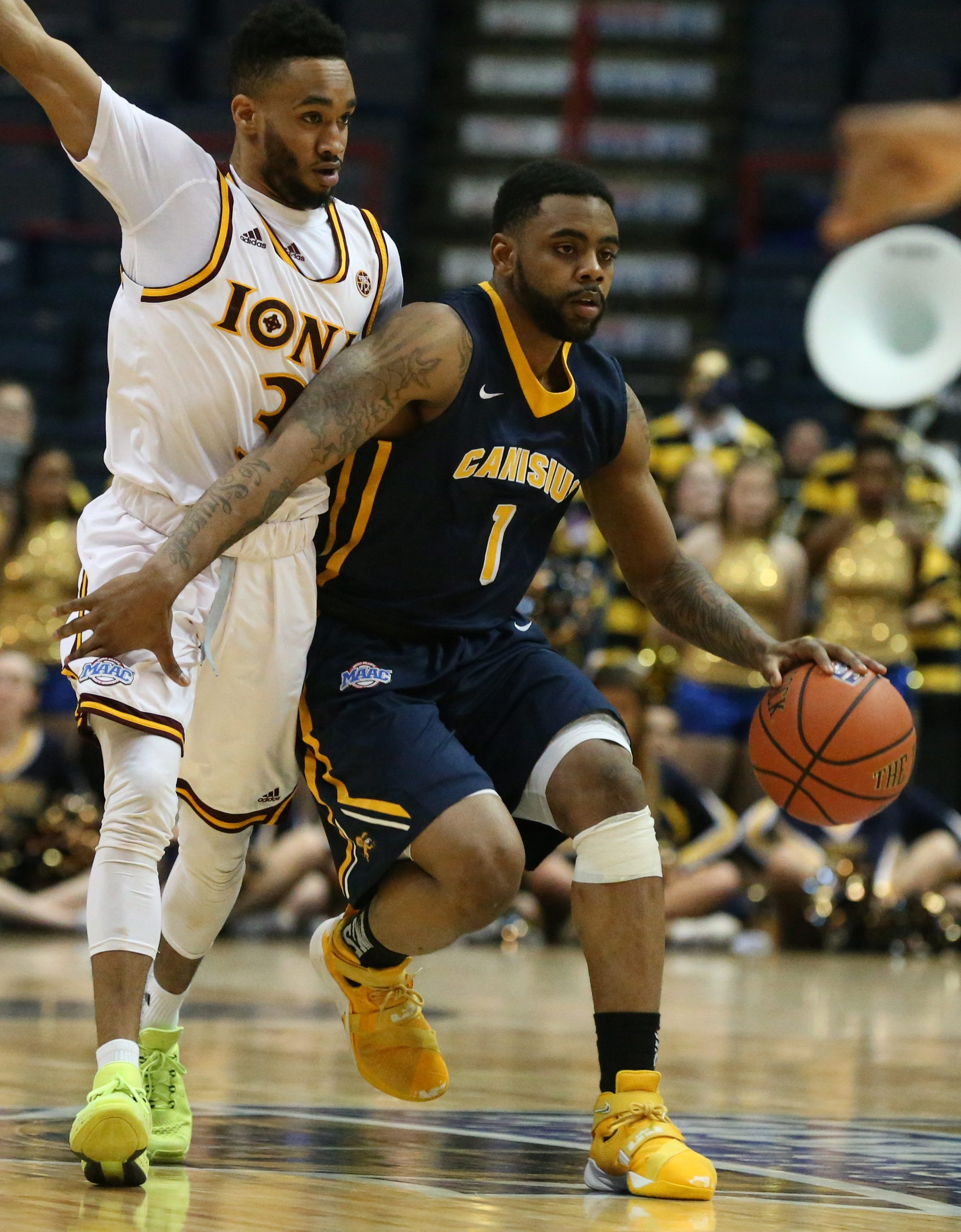 Canisius Golden Griffins guard Malcolm McMillan (1) brings the ball up the court in front of Iona Gaels guard Ibn Muhammad (3) in the first half of the men's quarterfinal game in the MAAC Championship at the Times Union Center in Albany,NY on Friday, March 4, 2016.  ()