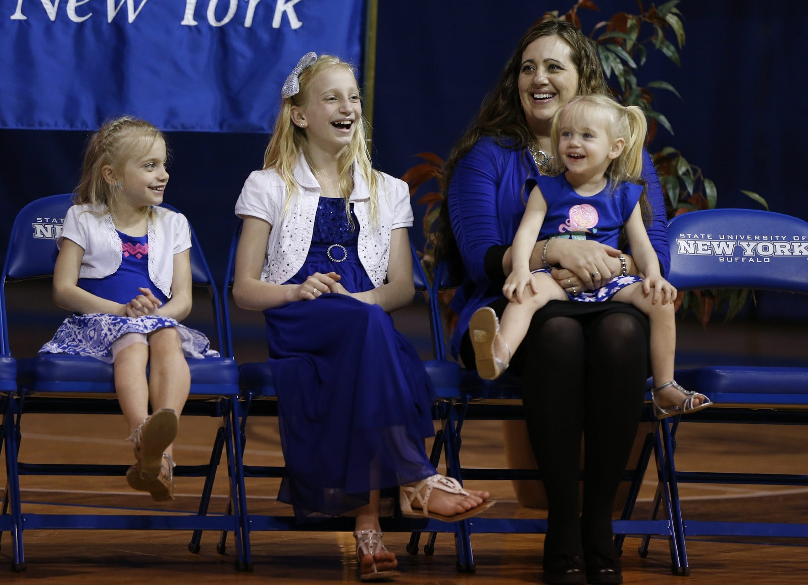 Crystal Oats and her daughters watch as Nate Oats is named the Bulls new head coach in 2015. (Harry Scull Jr./Buffalo News file photo)