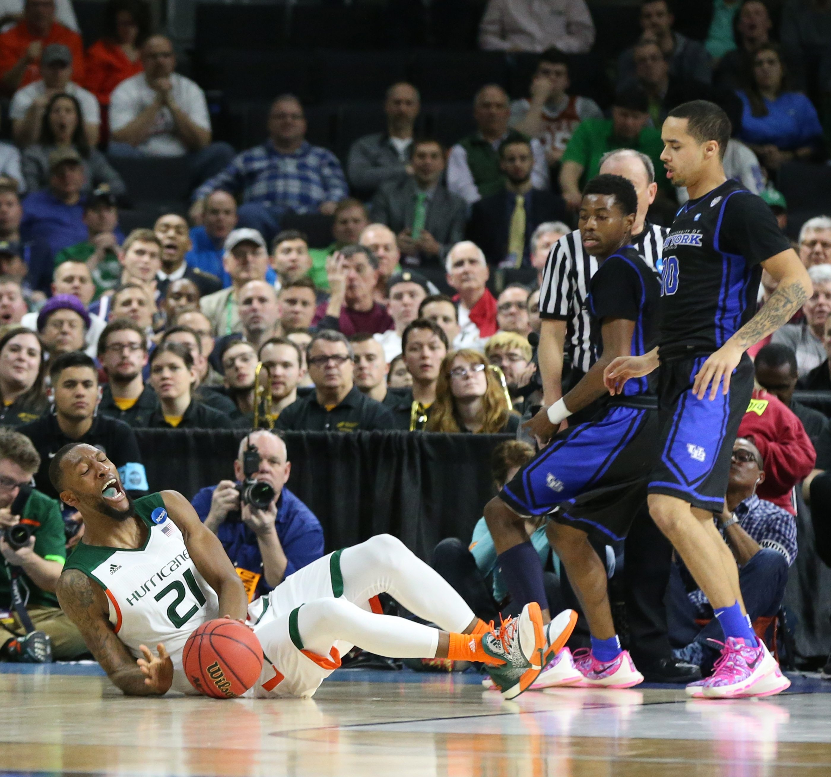 Buffalo Bulls guard Jarryn Skeete (10) fouls scores Miami (Fl) Hurricanes forward Kamari Murphy (21) in the second half in first round of NCAA Tournament at Dunkin' Donuts Center in Providence,RI on Thursday, March 17, 2016.  (James P. McCoy/ Buffalo News)
