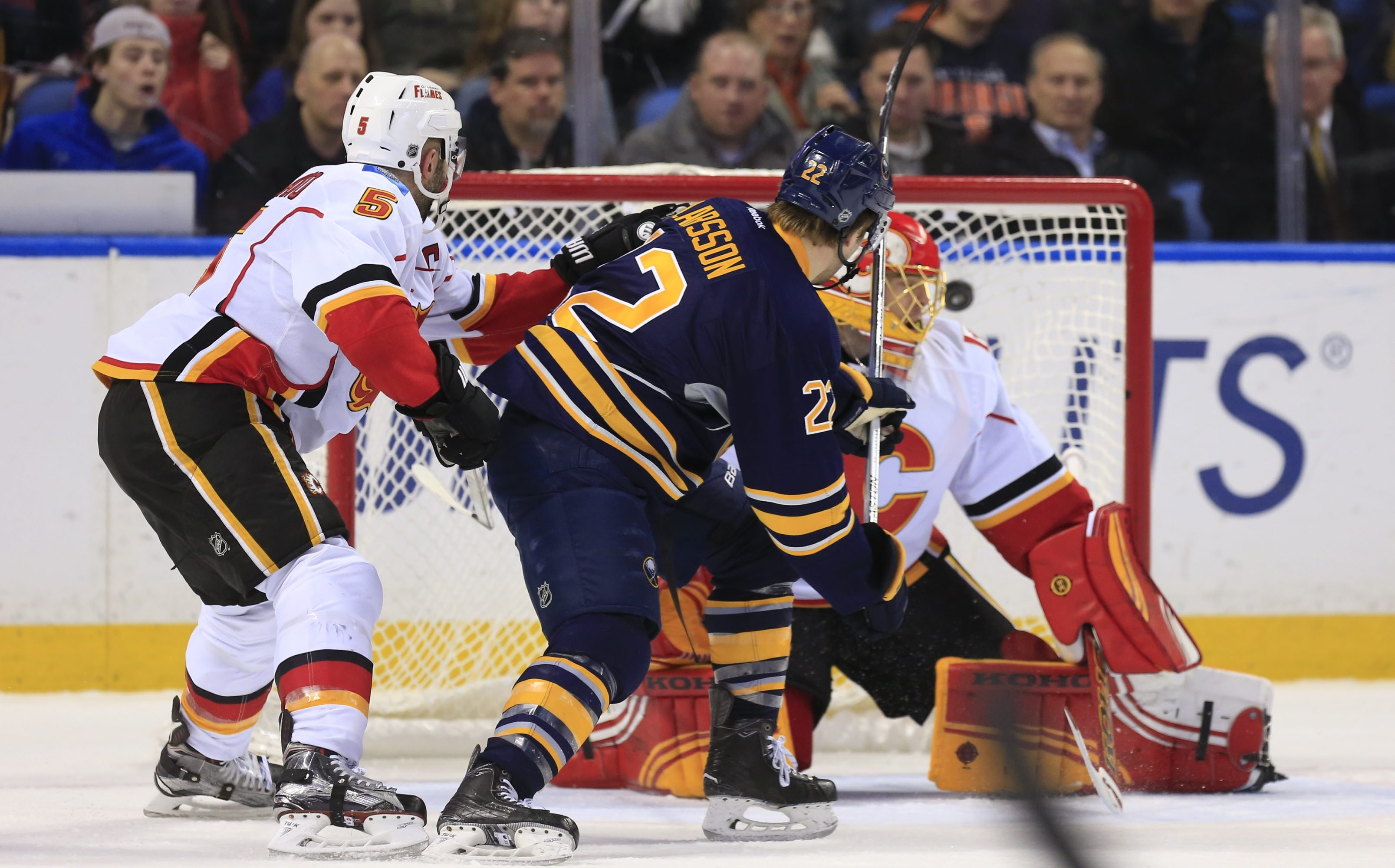 Sabre forward Johan Larsson scores the game-winning goal against Calgary during the third period Sunday.