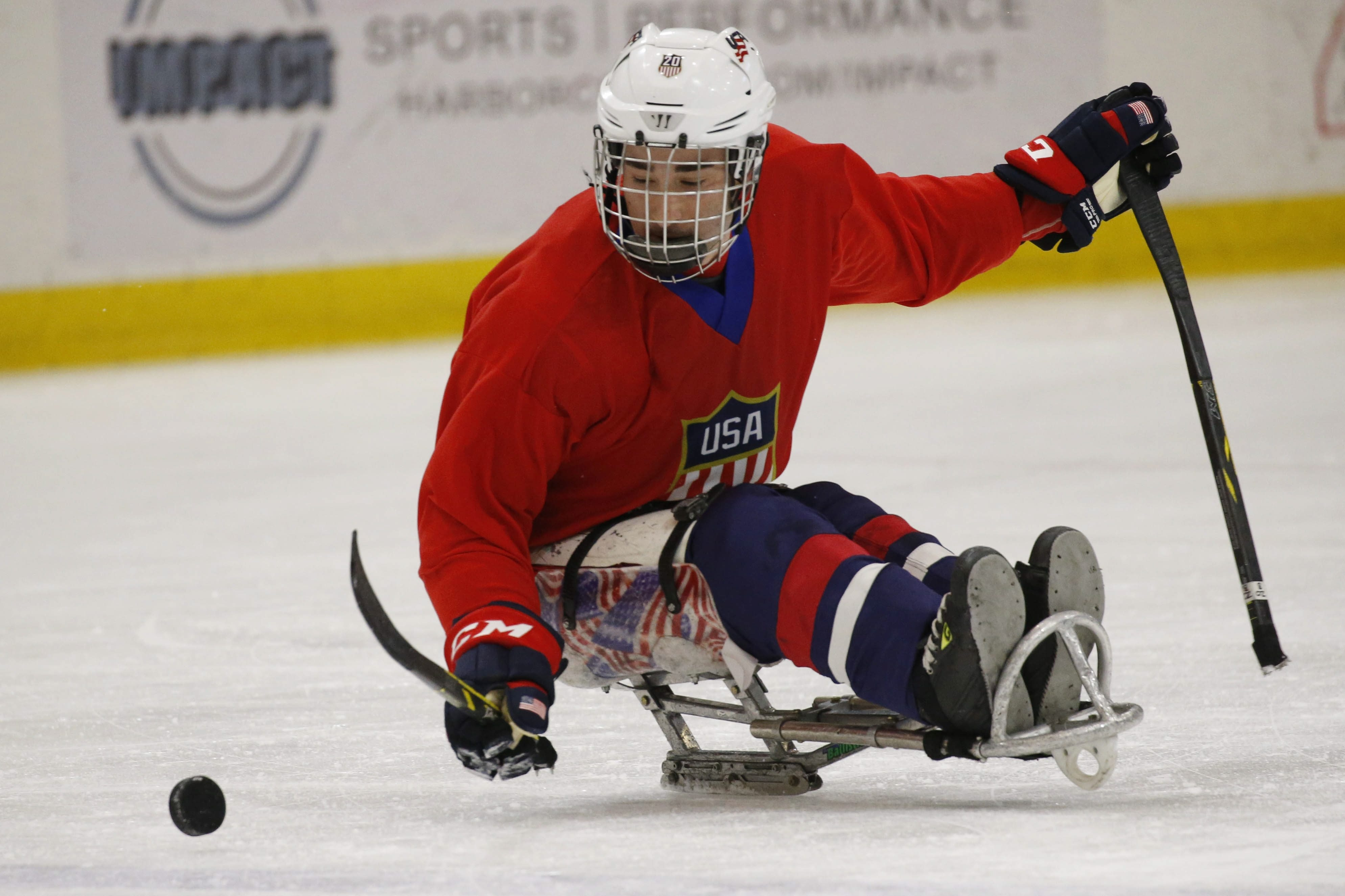 Adam Page moves the puck during Team USA practice at HarborCenter on Monday.